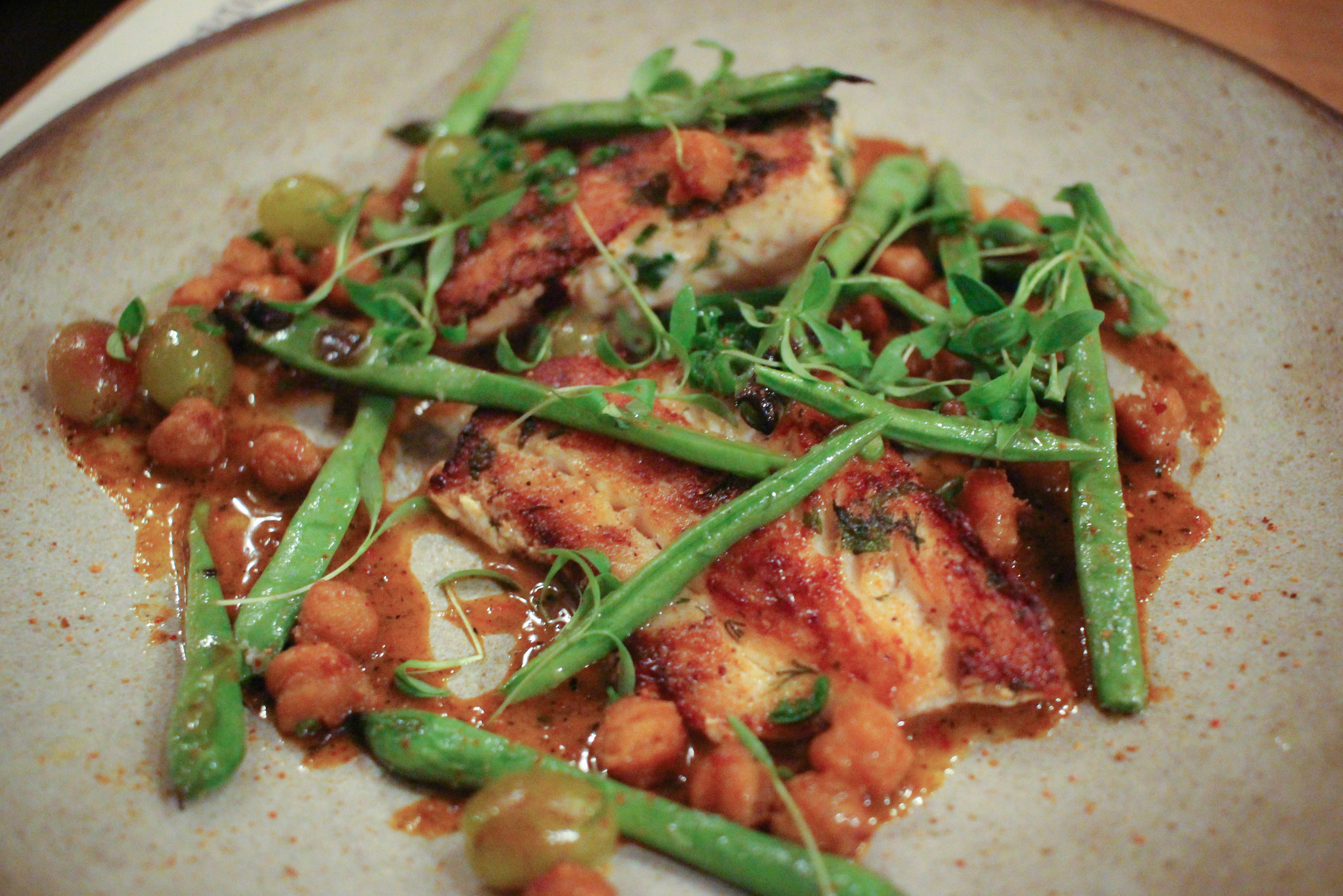 Grilled Monterrey fish with green beans, chickpeas, and roasted olives