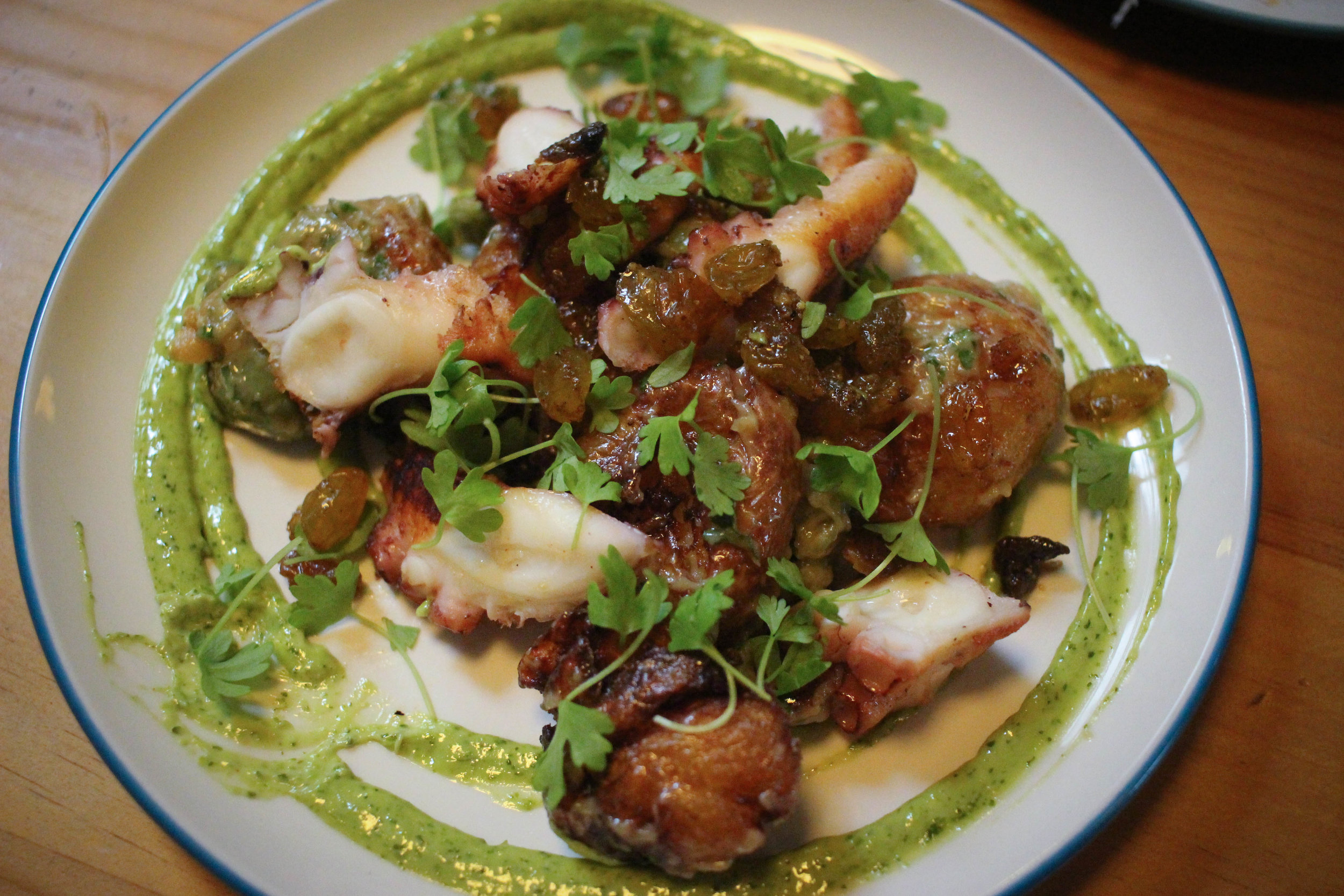 Roasted octopus, curried raisins, castelvetrano, butterball potatoes, fresh coriander