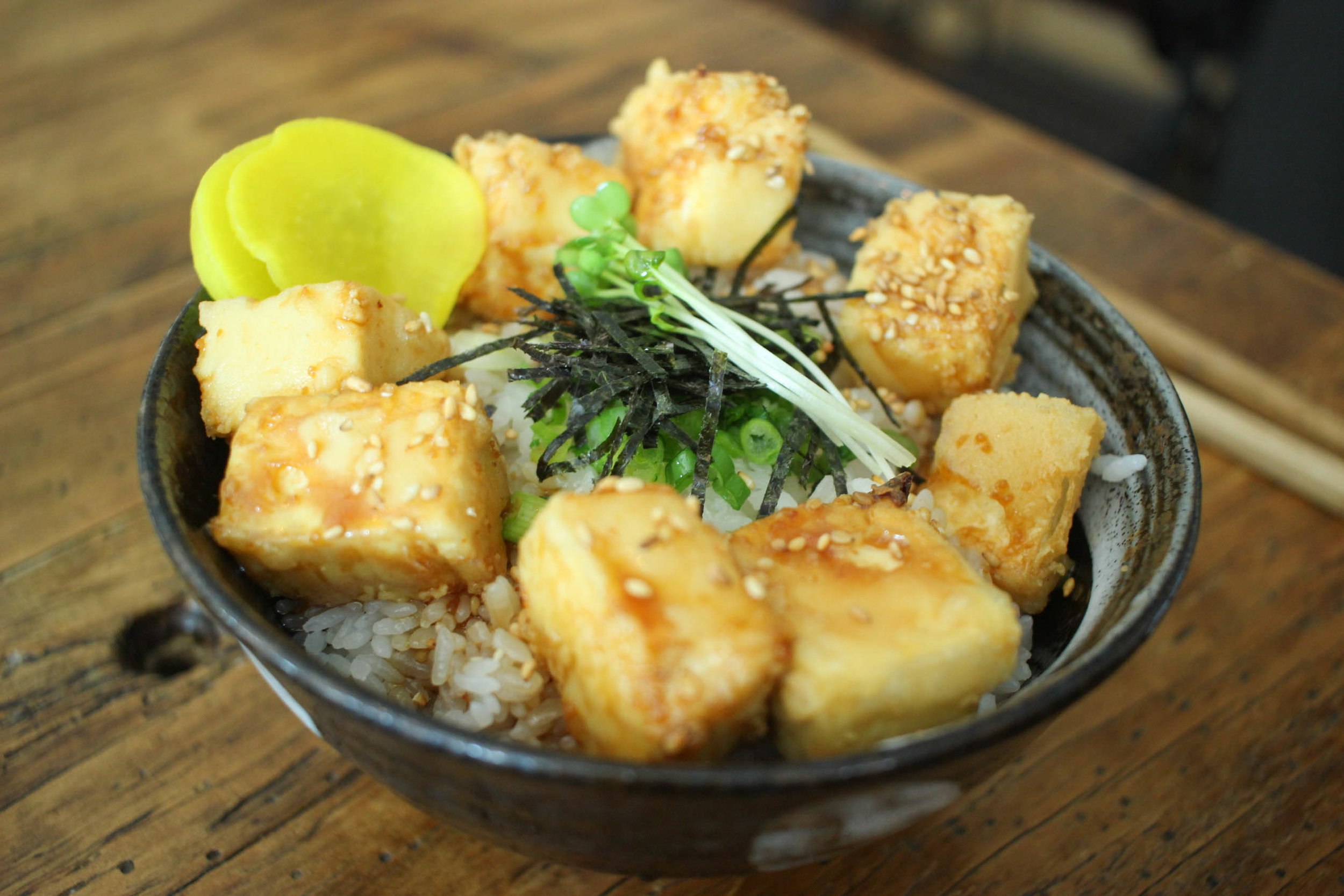 Tofu bowl with lightly deep-fried tofu served over rice.