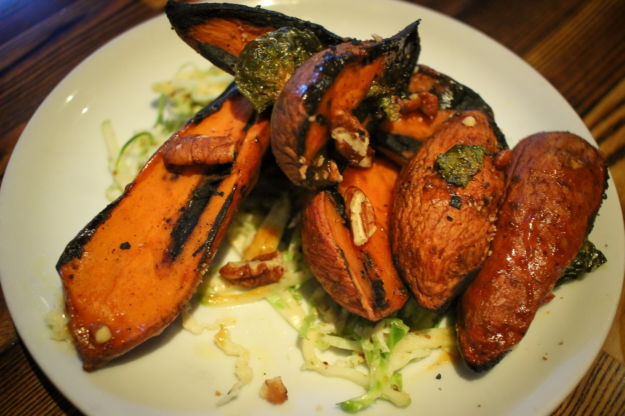 BBQ sweet potatoes with brussels-apple slaw and spiced pecans
