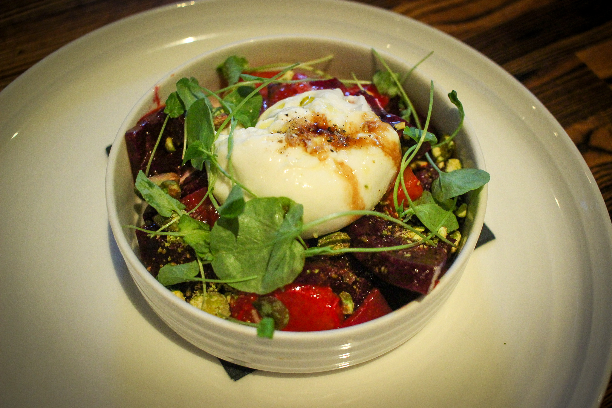 Smoked burrata with beets, citrus, pistachios, and Calabrian chilies