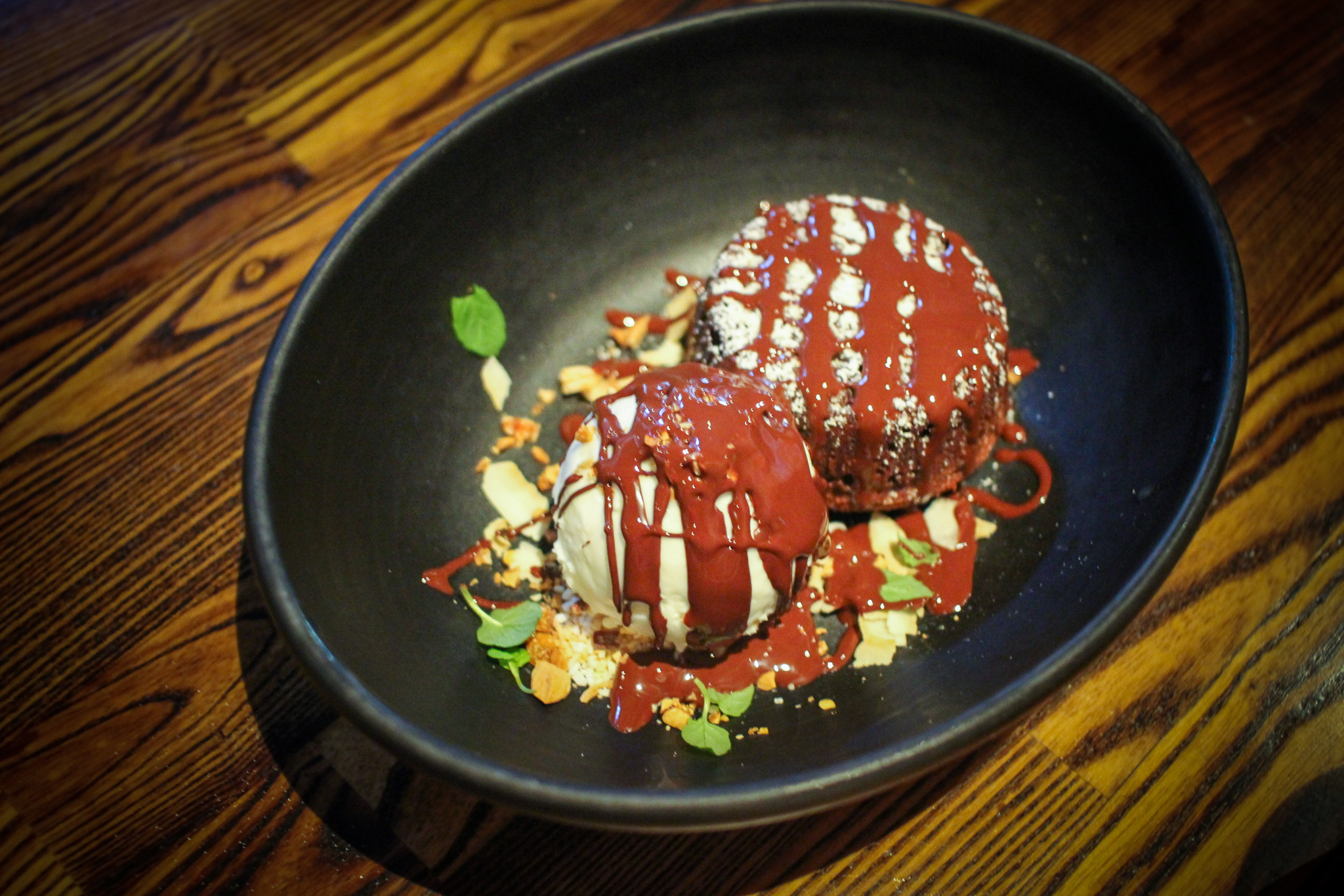"""Molten chocolate """"almond joy"""" with candied almonds and coconut gelato"""
