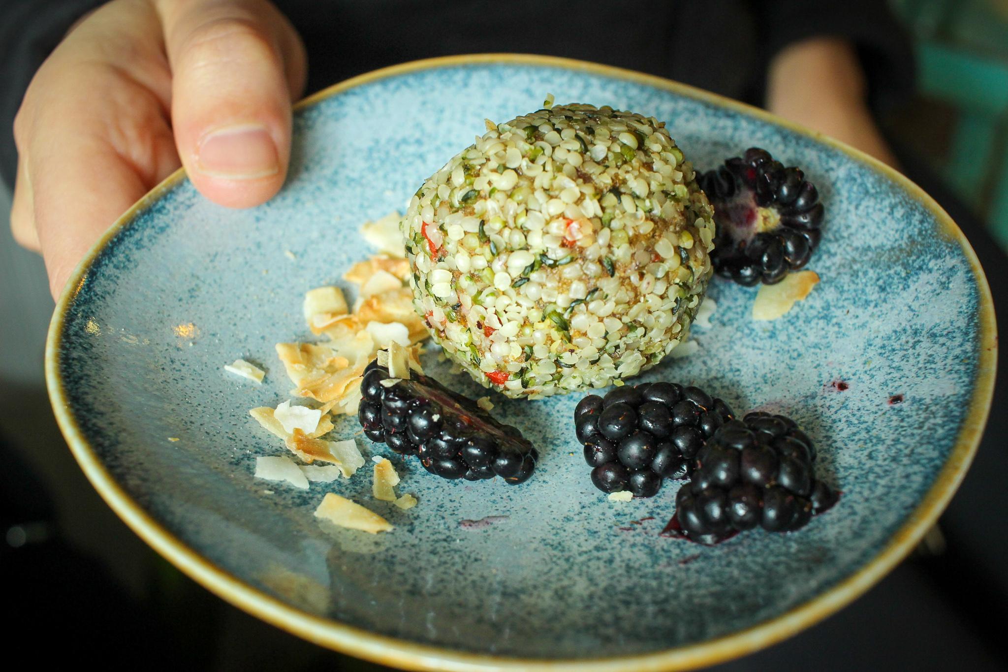Adaptogen ambrosia ball: dates, goji berries, golden berries, hemp seeds, chia seeds, coconut butter, maca, cinnamon, cardamom, coconut oil.