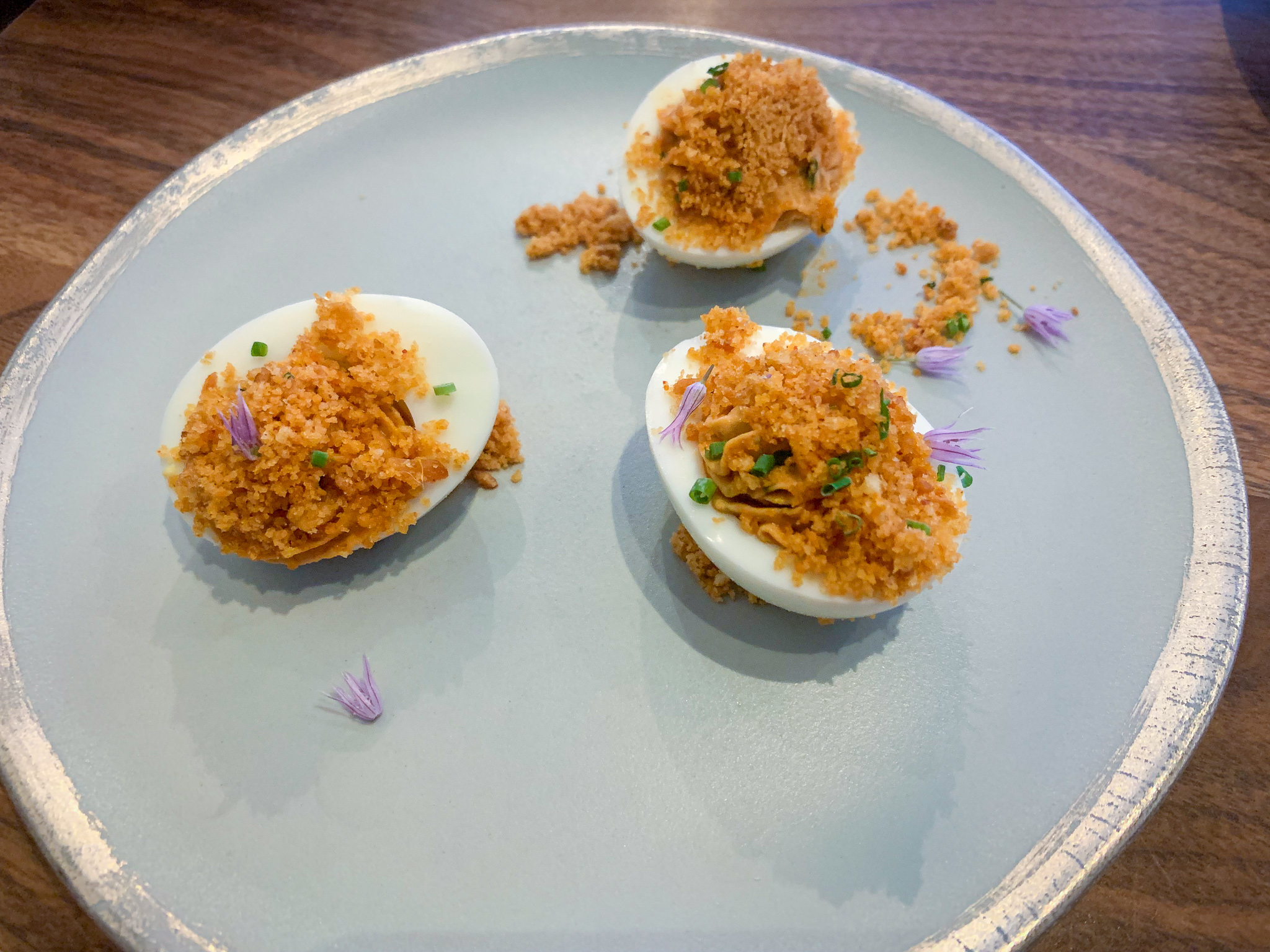 DEVILED EGGS  chive . red charmoula . crackling