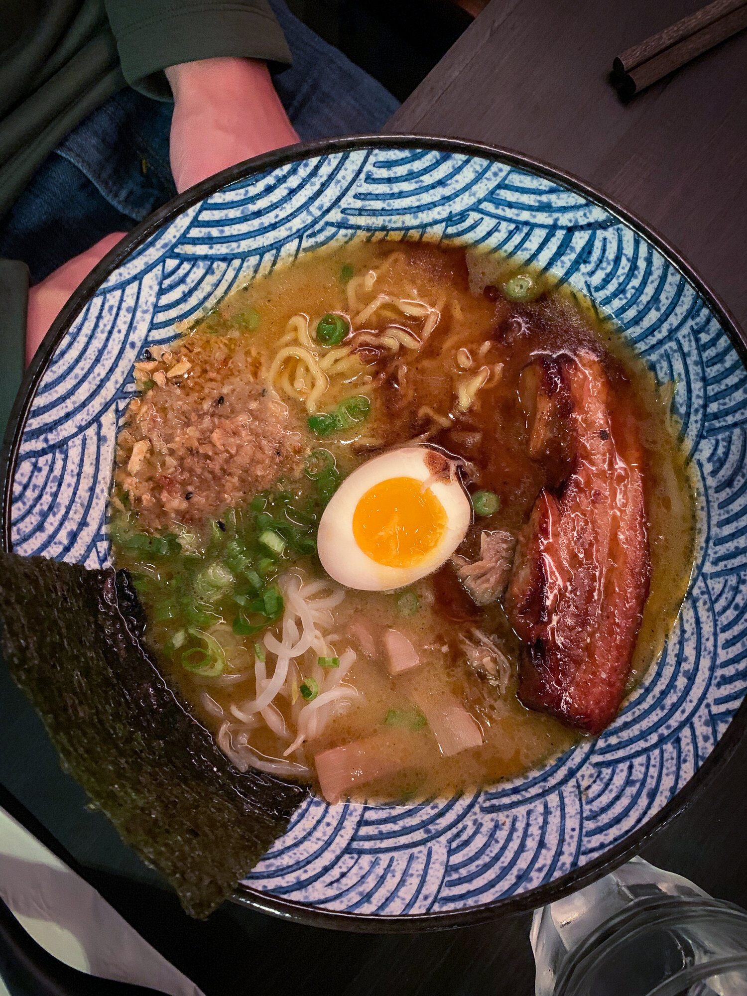 Signature Pork Ramen:  thick tonkotsu style 20 hour pork broth, pork chashu, 1/2 golden egg, bamboo shoots, bean sprouts, scallion, black garlic oil