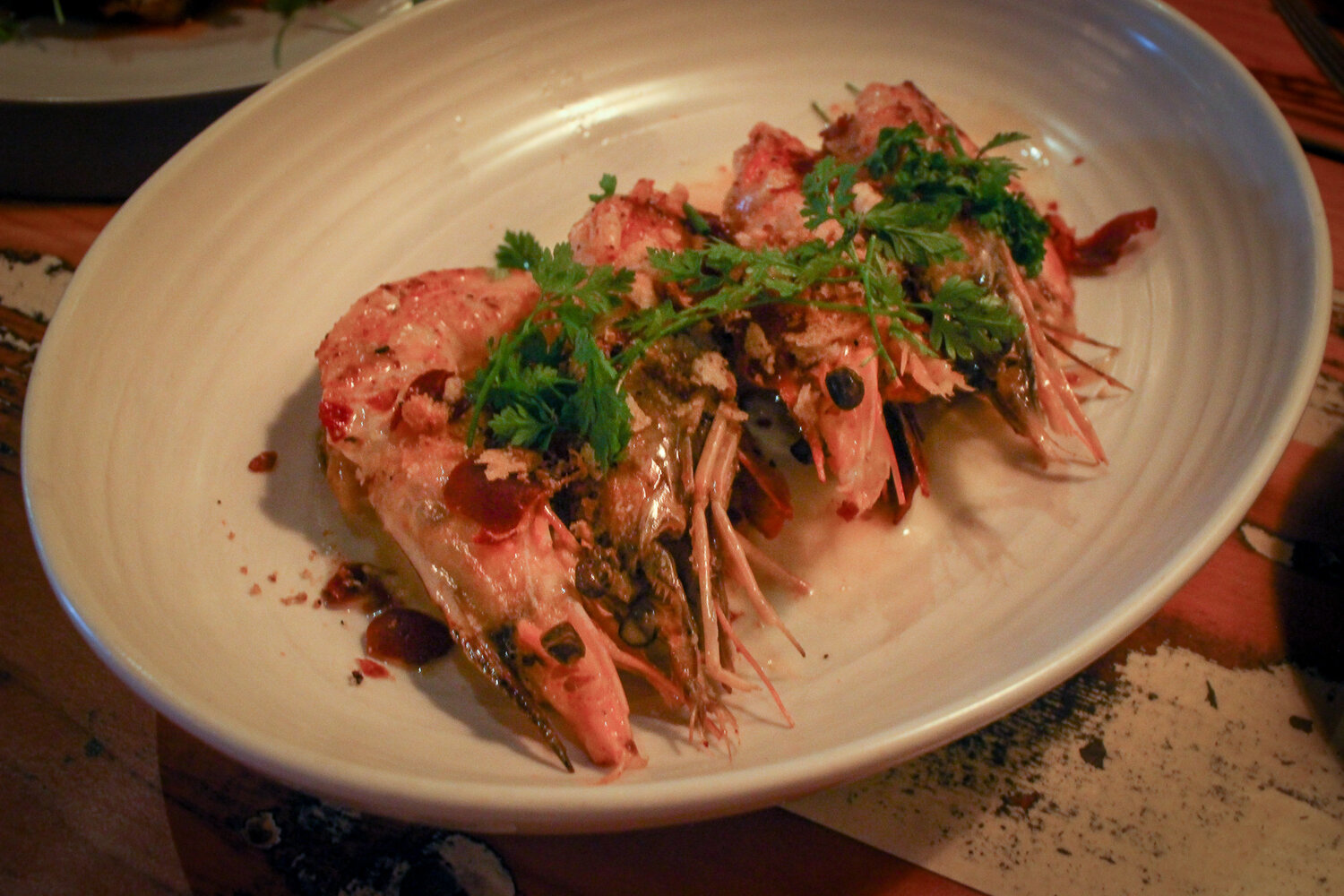Gulf prawns with Serrano ham, herbed butter, and breadcrumbs.