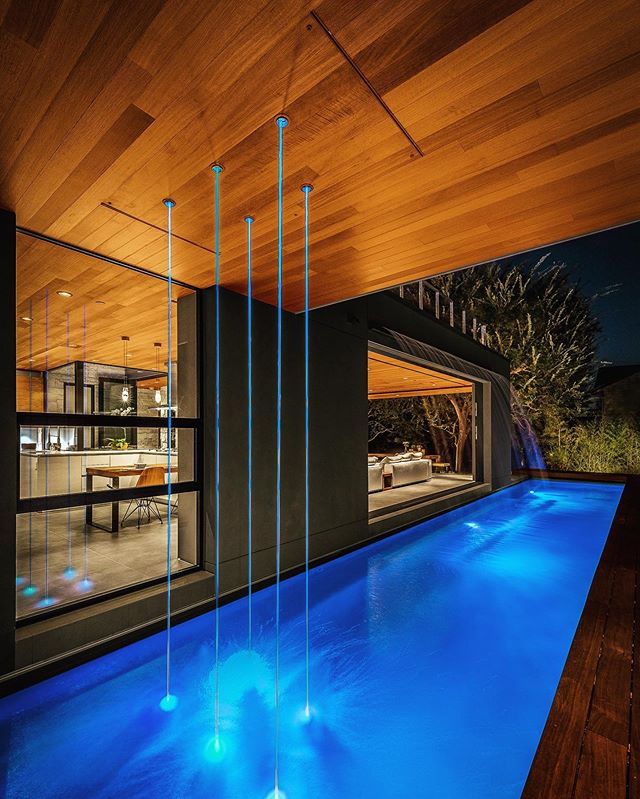 Having fun with custom laminar water features that look like light sabers coming out of the ceiling. Acacia House. 📷 Steve King. #hunterleggittstudio #acaciahousela #waterfeature #modernpool #whynot ..... . . . . #architecture #designbuild #modern #modernhouse #cool #losangeles #interiordesign #design #denver #modernindenver #lifegoals #cooldesign #modernwood #indooroutdoorliving #allcustom