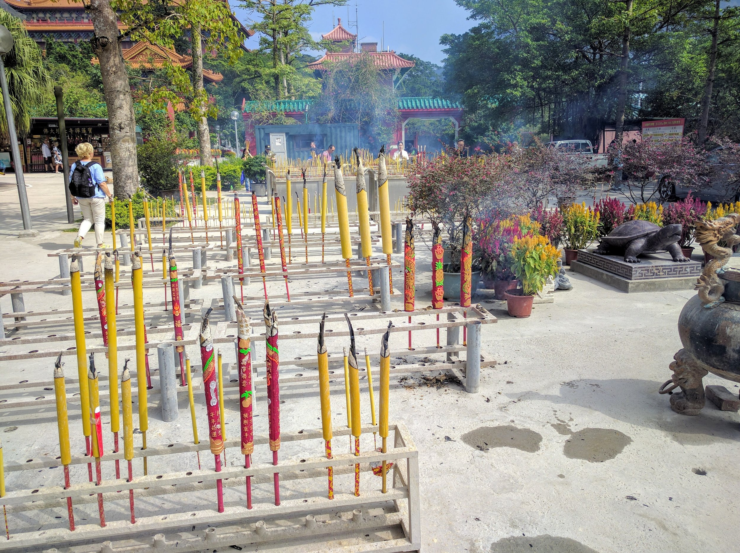 Making wishes with large bundles of burning incense at Po Lin Monastery // Hong Kong
