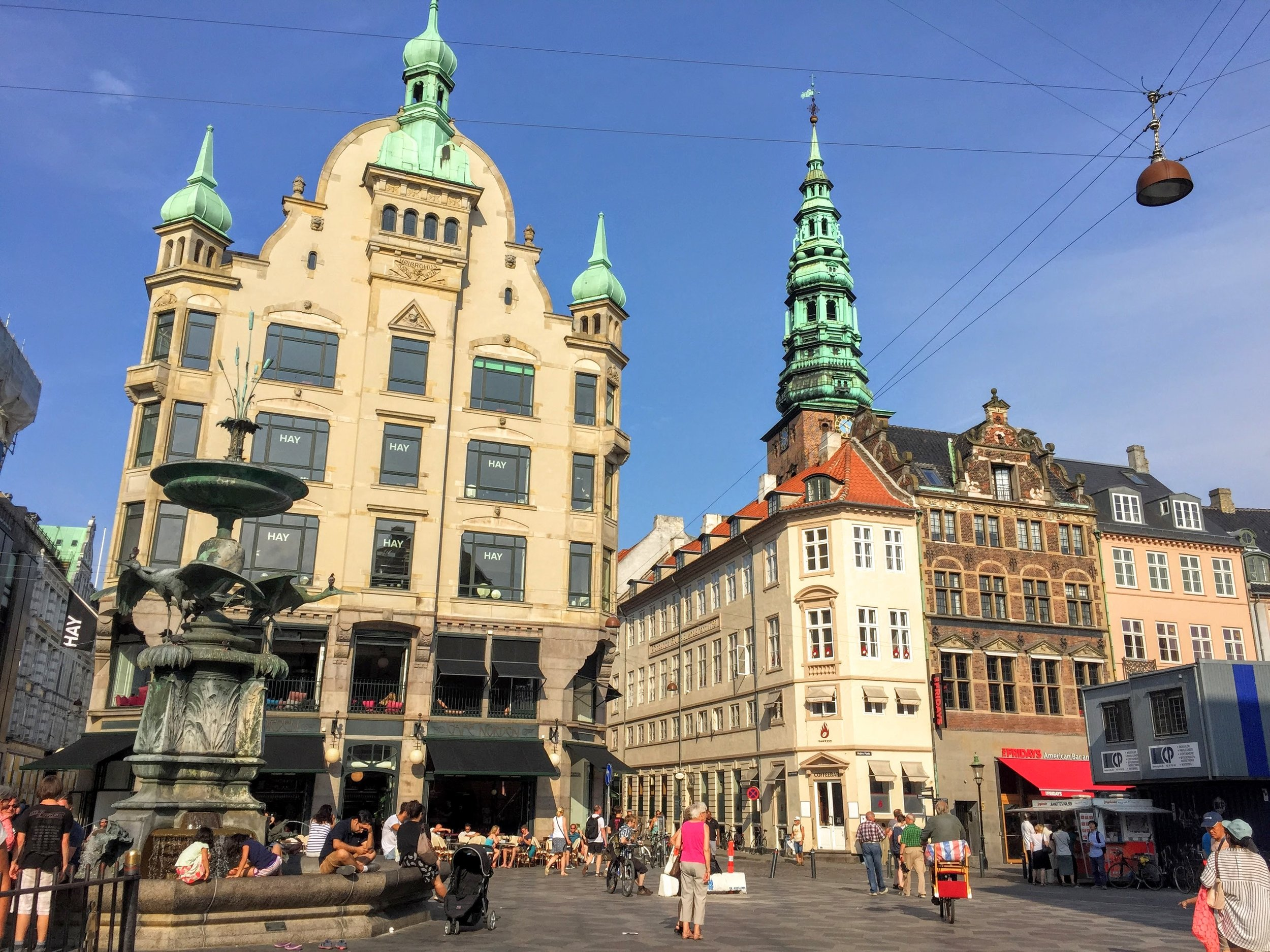 Some people watching and shopping on Strøget street // Copenhagen, Denmark