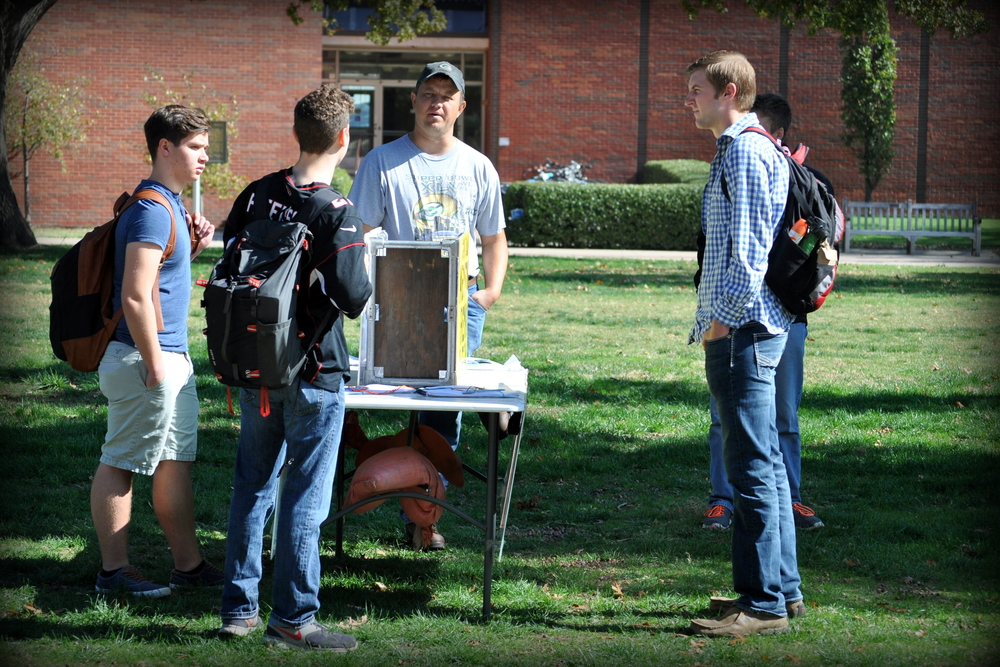 JFA veteran staff member  Paul Kulas  focuses his attention on a University of Oklahoma student in November.