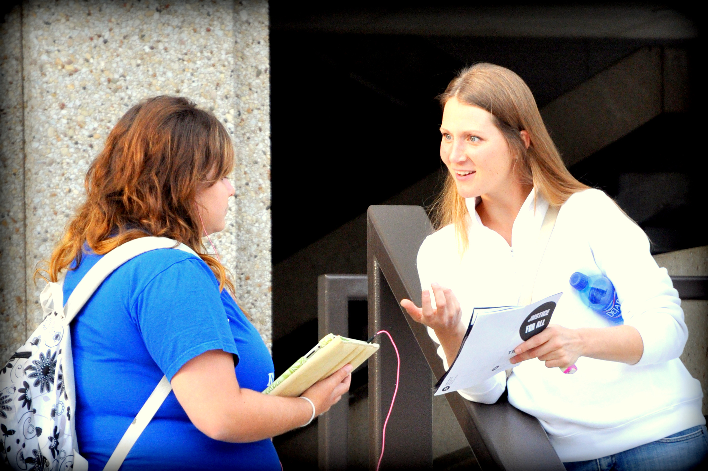 Rachelle interacts with a student at the University of Kansas in 2012.