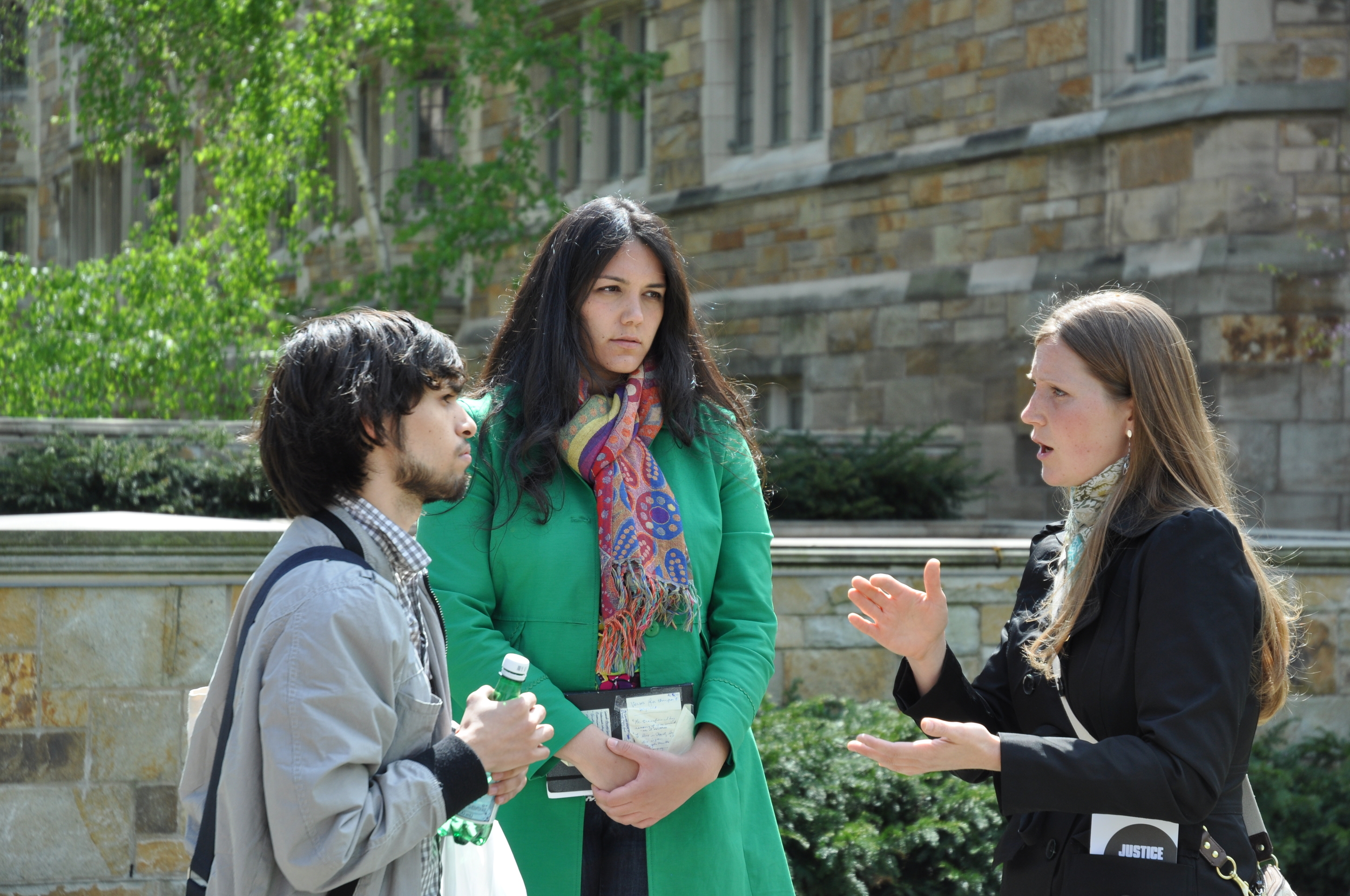 JFA volunteers Antionette (green) and Rachelle (black) interact with a student at Yale University in 2012.  Antionette now leads a pro-life ministry called  Mafgia .