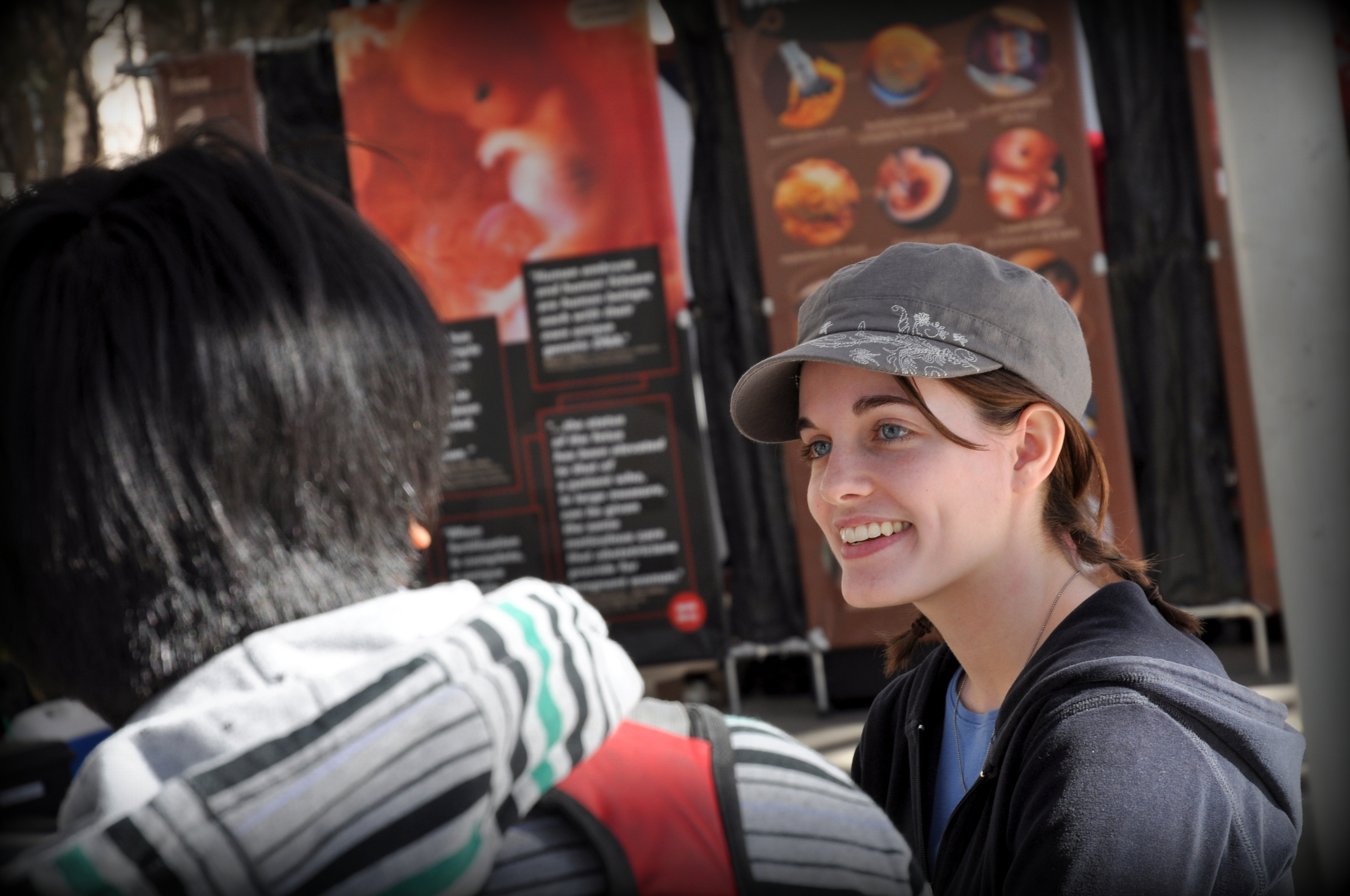 Holly in conversation with a student at JFA's outreach event at Arizona State University (ASU), February 2014