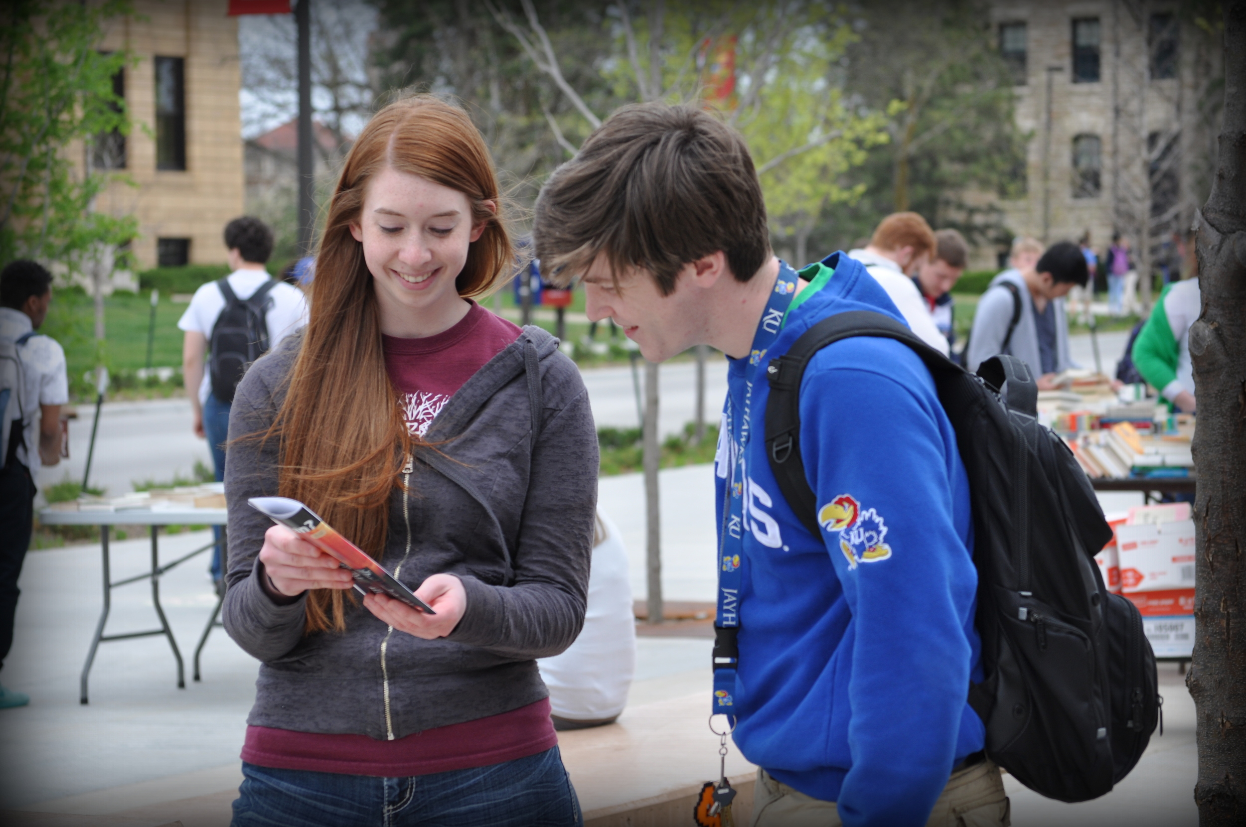 During her sophomore year of college, Laura Haschke (above) came on a mission trip with Justice For All to participate in seminars and outreach events near the University of Kansas (KU). She is shown here sharing the JFA Exhibit Brochure with a KU student.