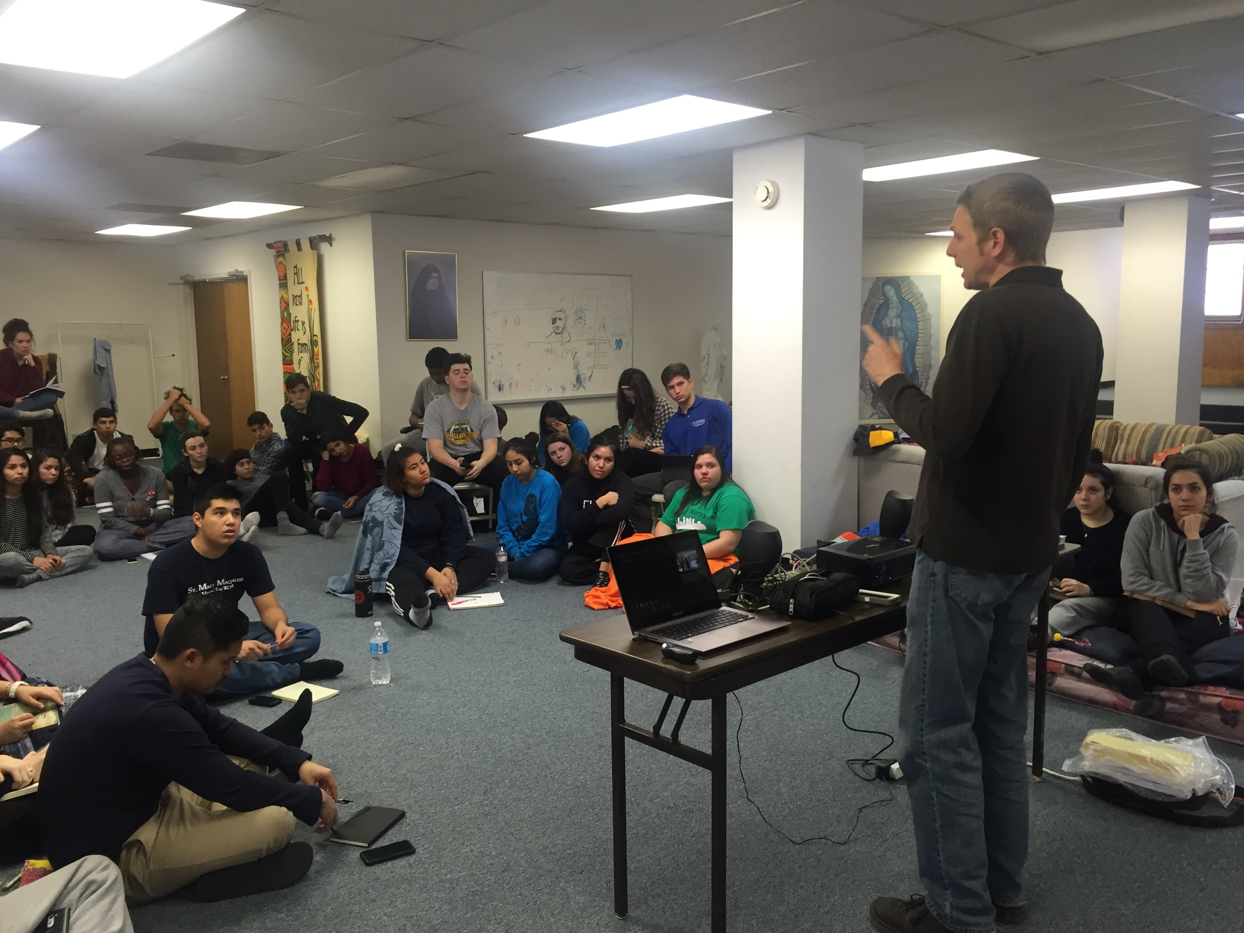 Students from Phoenix and I work on pro-life dialogue skills in a makeshift basement seminar environment. They were troopers!