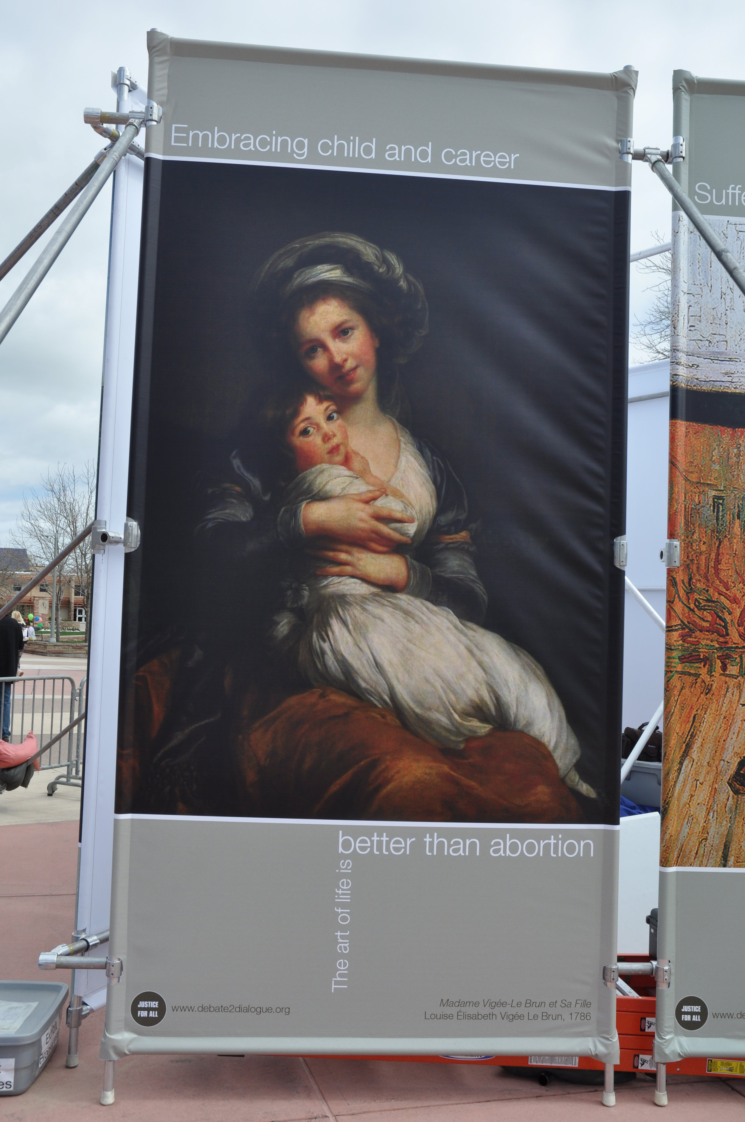 This panel of JFA's  Art of Life Exhibit features  Madame Vigée-Le Brun et sa fille, Jeanne-Lucie, dite Julie by Louise Élisabeth Vigée Le Brun. It's a self-portrait completed in France in 1786. For more commentary, see  this letter . For more on the image, see  the  Art of Life page .