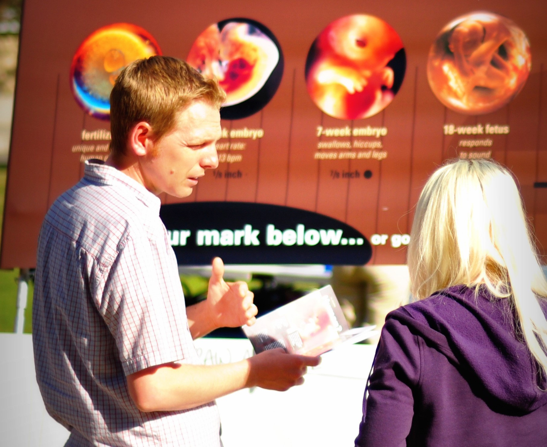 Steve Wagner  interacts with a student at a Fresno, California outreach.