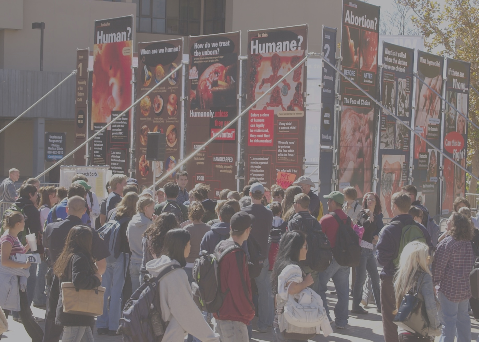 Justice For All's 2000 Exhibit creates controversy and conversation with pictures of the unborn before and after abortion at the University of New Mexico in 2006. Click the image or  this link  to see the Exhibit.