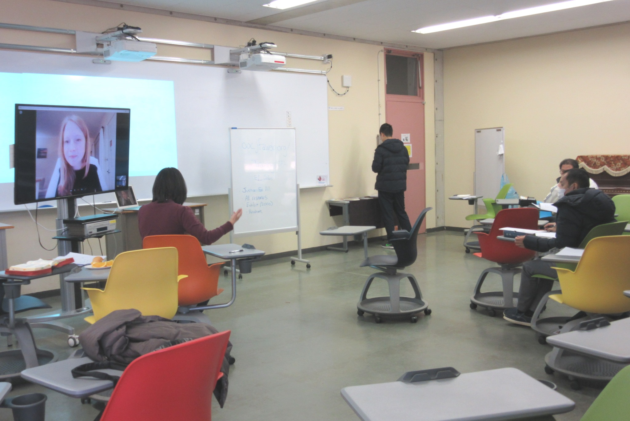 JFA trainer Joanna Bai (left, on screen) led the JFA workshop at Tokyo Christian University for 19 participants (not all in view).