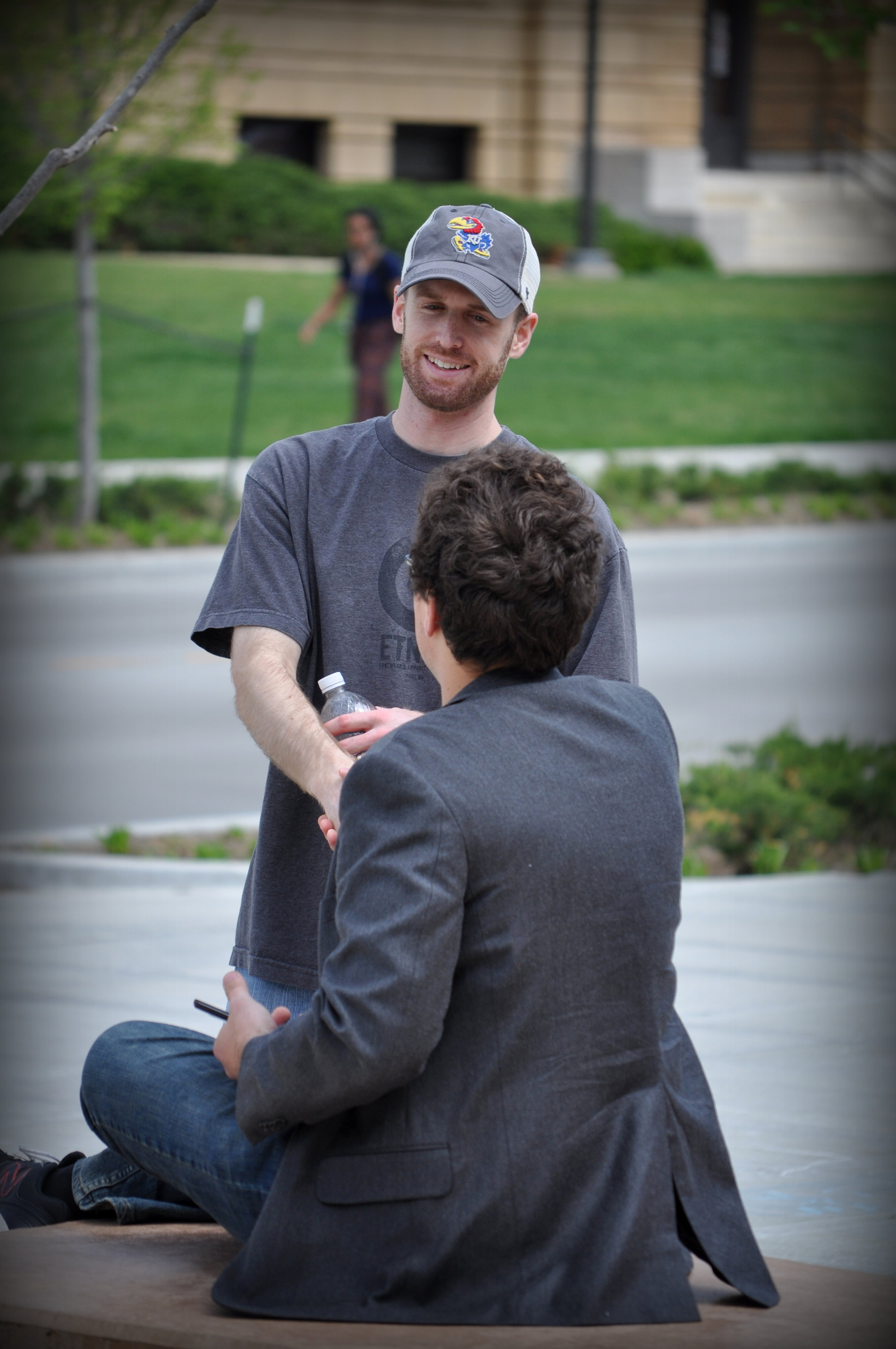 Spencer Stewart talks with a University of Kansas (KU) student at a JFA outreach event in April 2015.