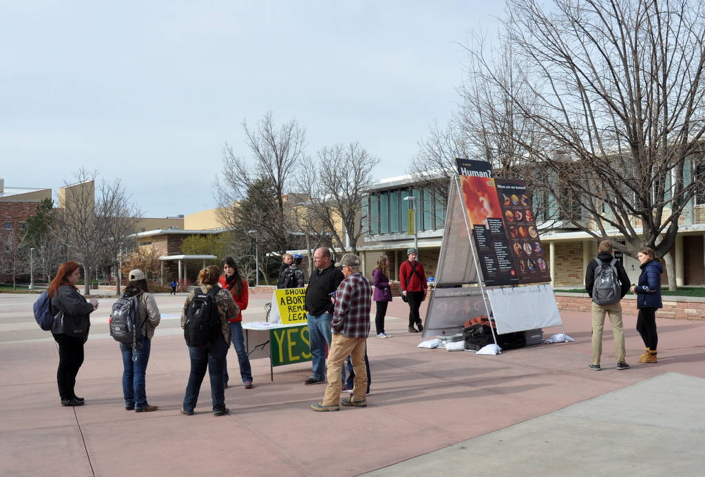 Four simultaneous conversations are shown taking place during JFA's outreach event at Colorado State University (CSU) in April 2018.