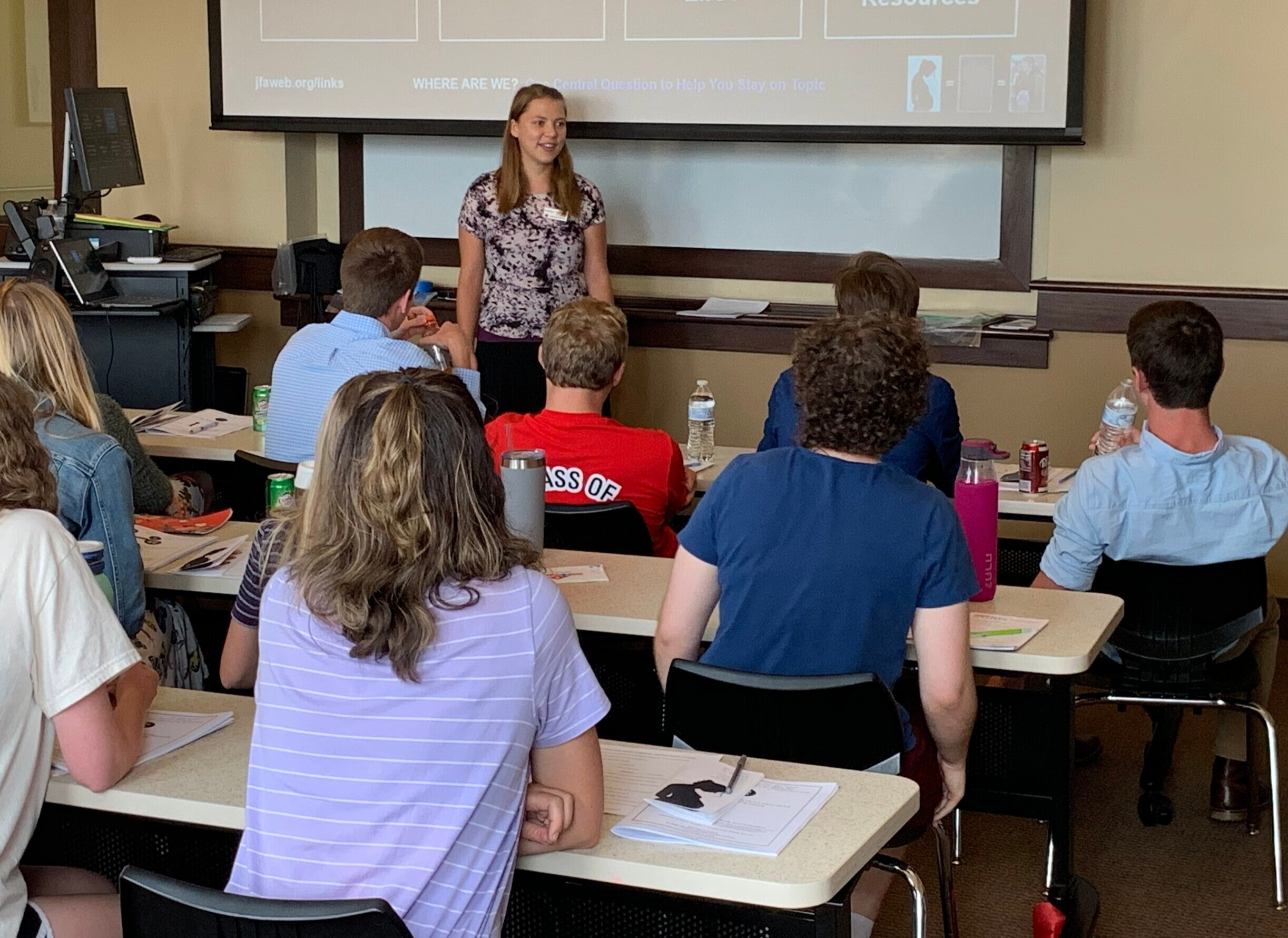 Sunday (Benedictine College):  Kaitlyn Donihue  speaks to 28 students (not all pictured) who attended the Sunday seminar. Ten returned on Monday night for advanced dialogue training.