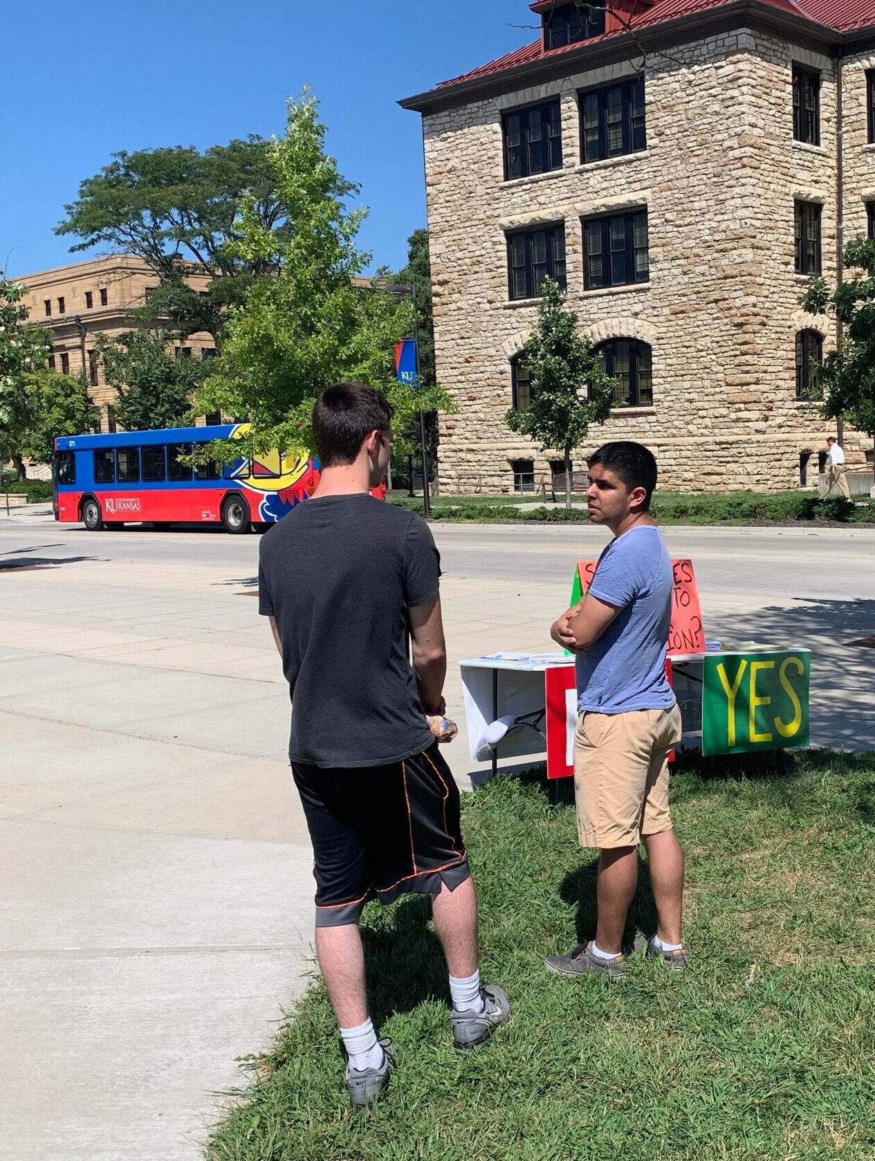 Wednesday (KU): Eric (right), president of the  Wichita chapter of Life Runners , talks with a KU student.