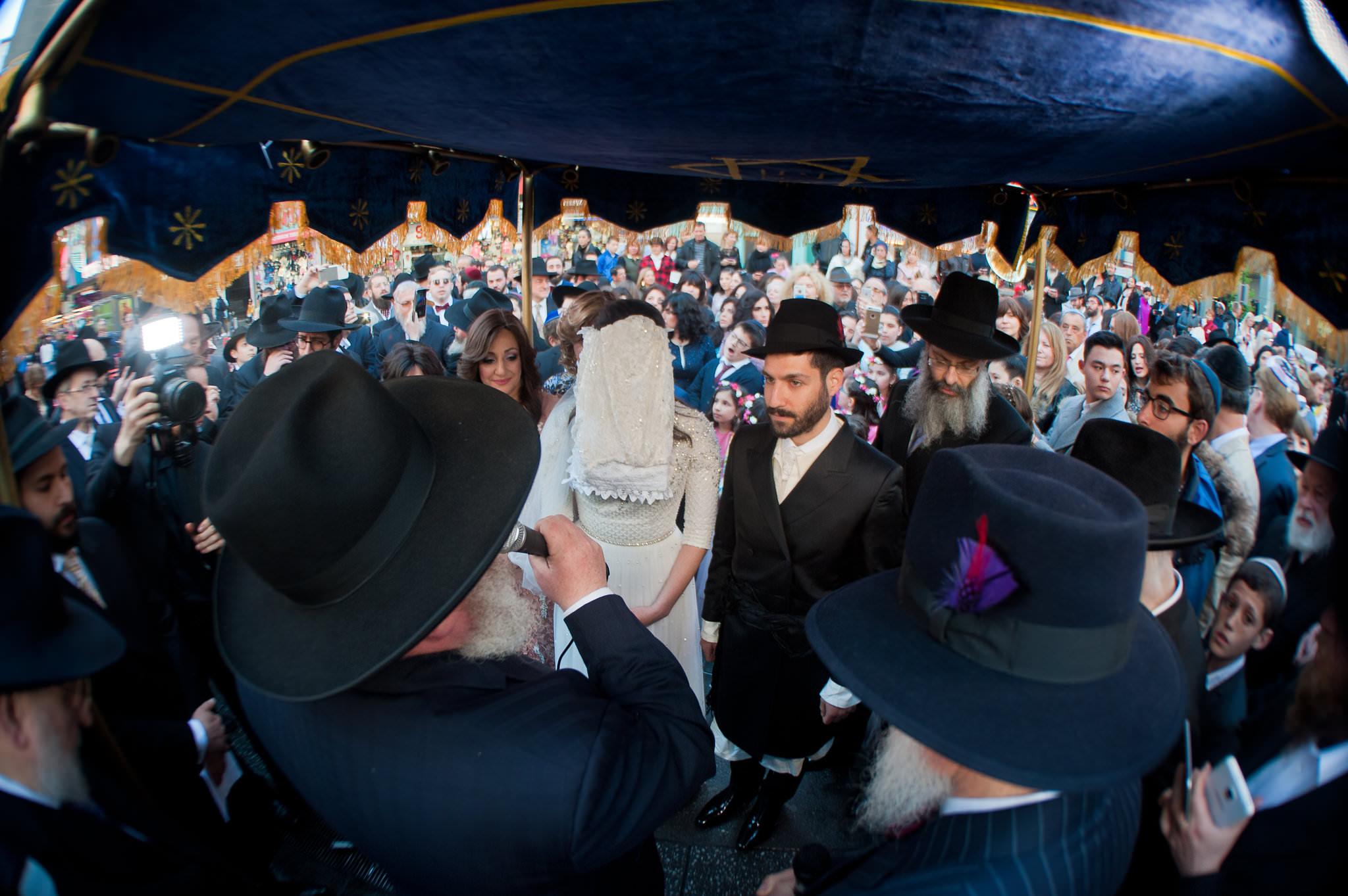Historic Chabad Orthodox Jewish Wedding in Times Square Manhattan New York NYC Photo by Chaim Schvarcz, bride, groom, chuppah, under the chuppah