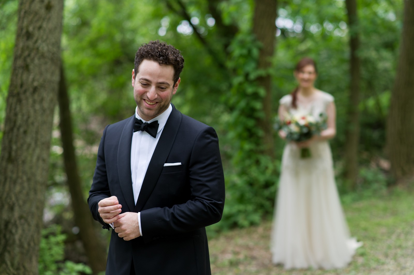 Yoey and Aaron's Memorial Day Modern Jewish Wedding at Anthony's Pier 9, New Windsor, NY Photos by Chaim Schvarcz first look bride groom gown suit flowers portraits