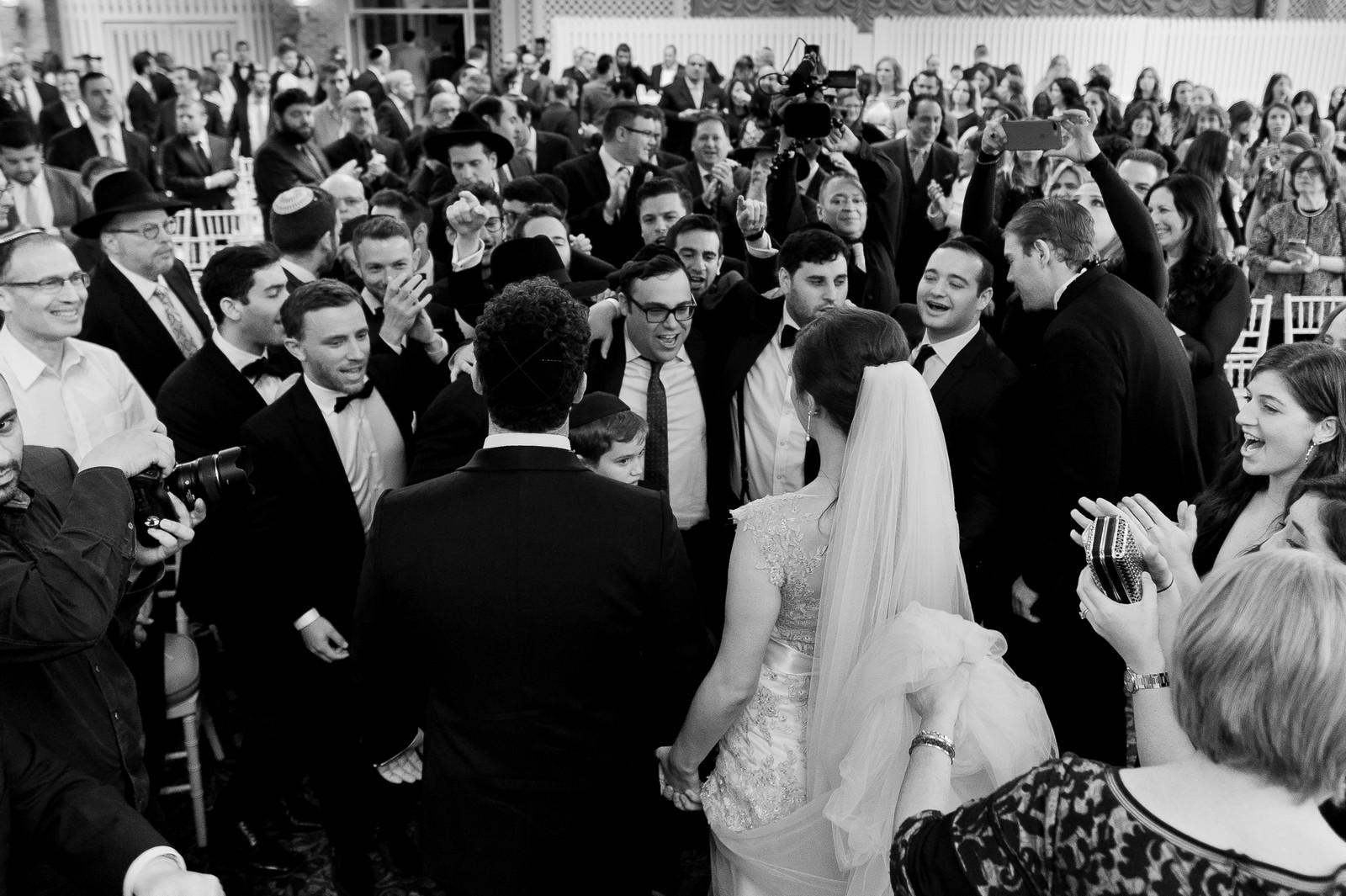 Yoey and Aaron's Memorial Day Modern Jewish Wedding at Anthony's Pier 9, New Windsor, NY Photos by Chaim Schvarcz bride groom dancing