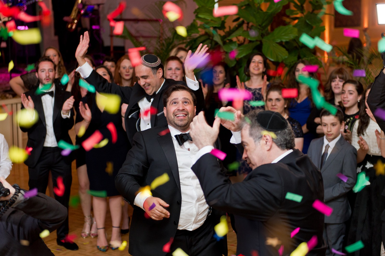 Yoey and Aaron's Memorial Day Modern Jewish Wedding at Anthony's Pier 9, New Windsor, NY Photos by Chaim Schvarcz dancing confetti