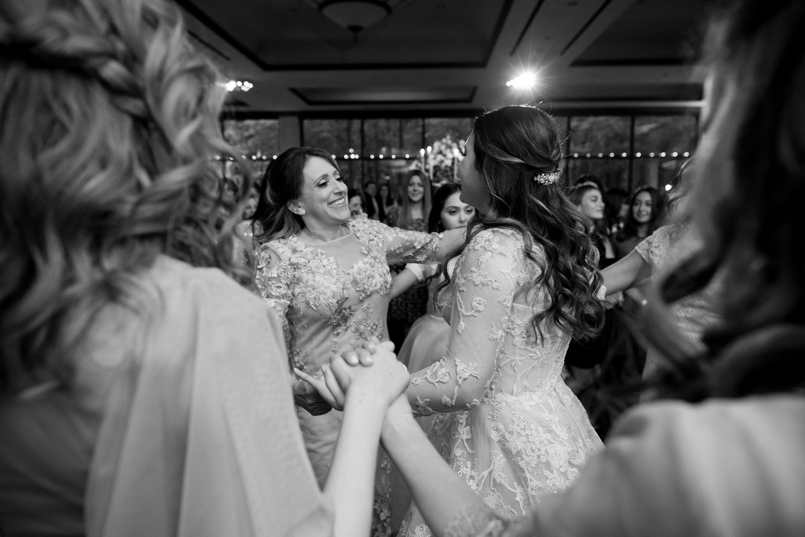 Abby and Miles' Modern Jewish Wedding at Nicotra's Ballroom, Hilton Garden Inn, Staten Island, NY, Photos by Chaim Schvarcz bride dancing