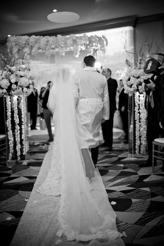 Danna and Eitan's Modern Orthodox Jewish Wedding at The Sands, Atlantic Beach, NY Photos by Chaim Schvarcz bride groom walk down isle chuppah