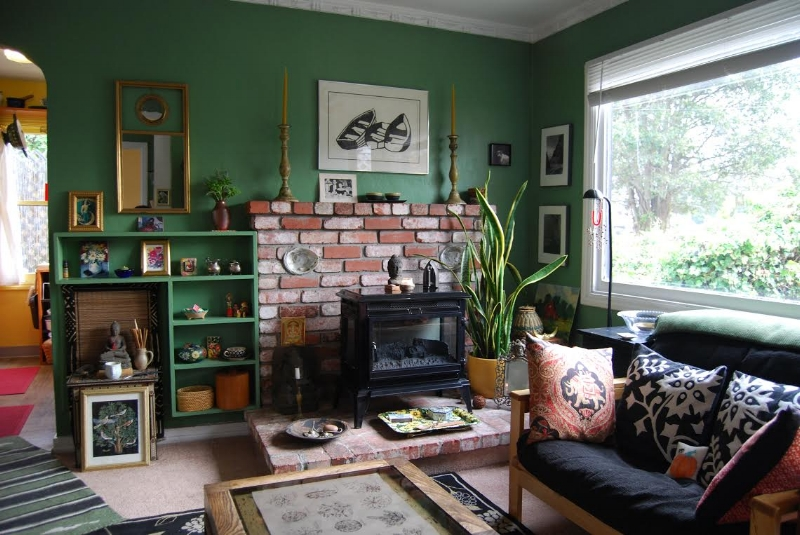 Cottage living: Suzanne brings the outside in with botanical motifs and earthy green walls.