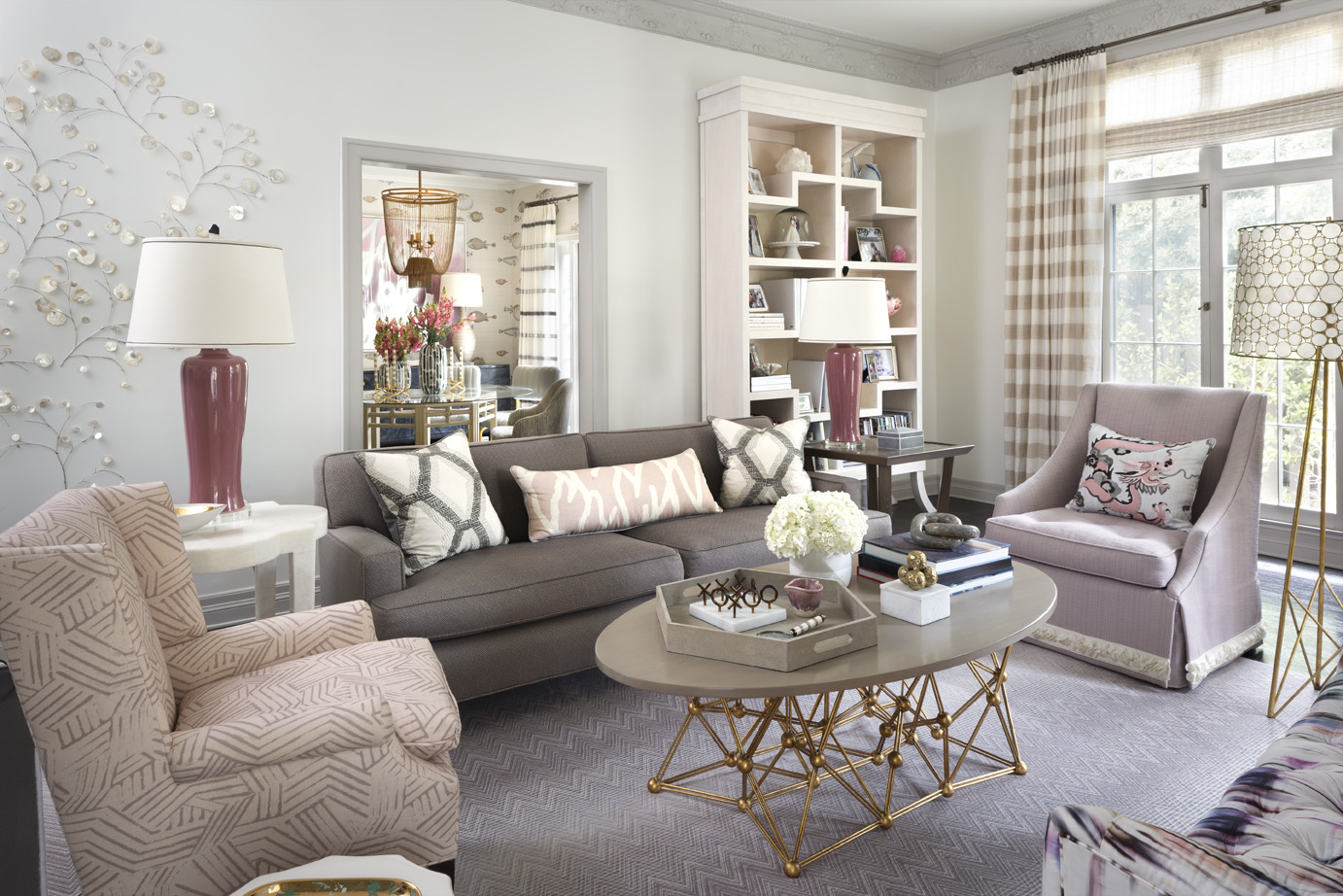 PATTERN PLAY: Melissa's living room featuring her newly upholstered armchair in Miramar fabric (color: shell) Photo credit: Grey Crawford