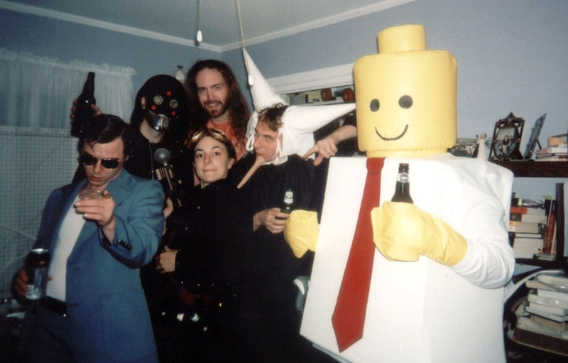 Frank realized belatedly the flaw in his Legoman Drinking Costume.