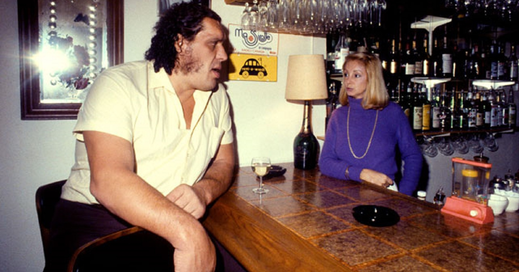 """BARTENDER, politely: """"Can I start you off with something to drink?"""" ANDRE, intently: """"All."""""""