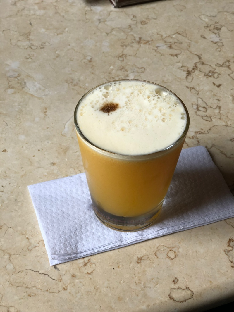This is actually a  maracuya sour which is a passionfruit pisco cocktail, and my particular favorite.