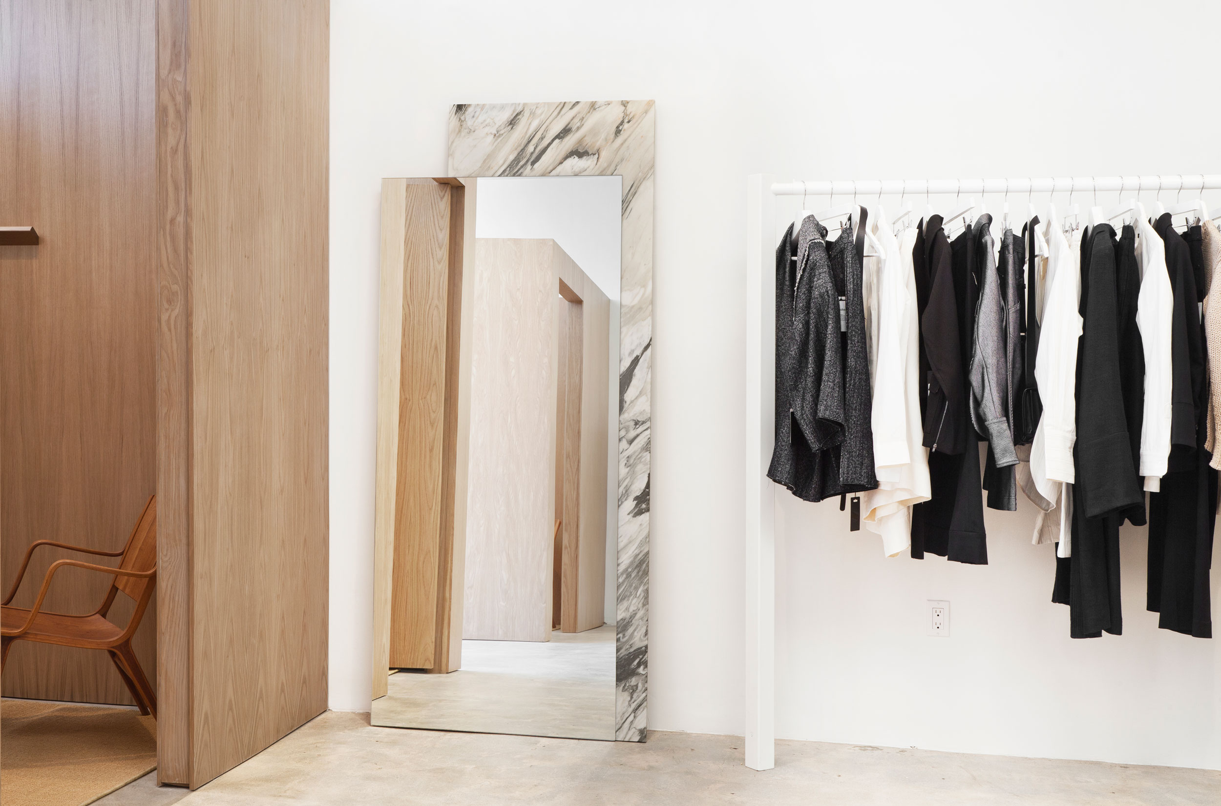 The design for the leaning mirror was conceived when Mimi saw a random composition of materials stacked against our studio walls. She took this visual language and designed a mirror using the most beautiful cut of Mountain Calacatta marble and chamfered glass to create the same effortless look.
