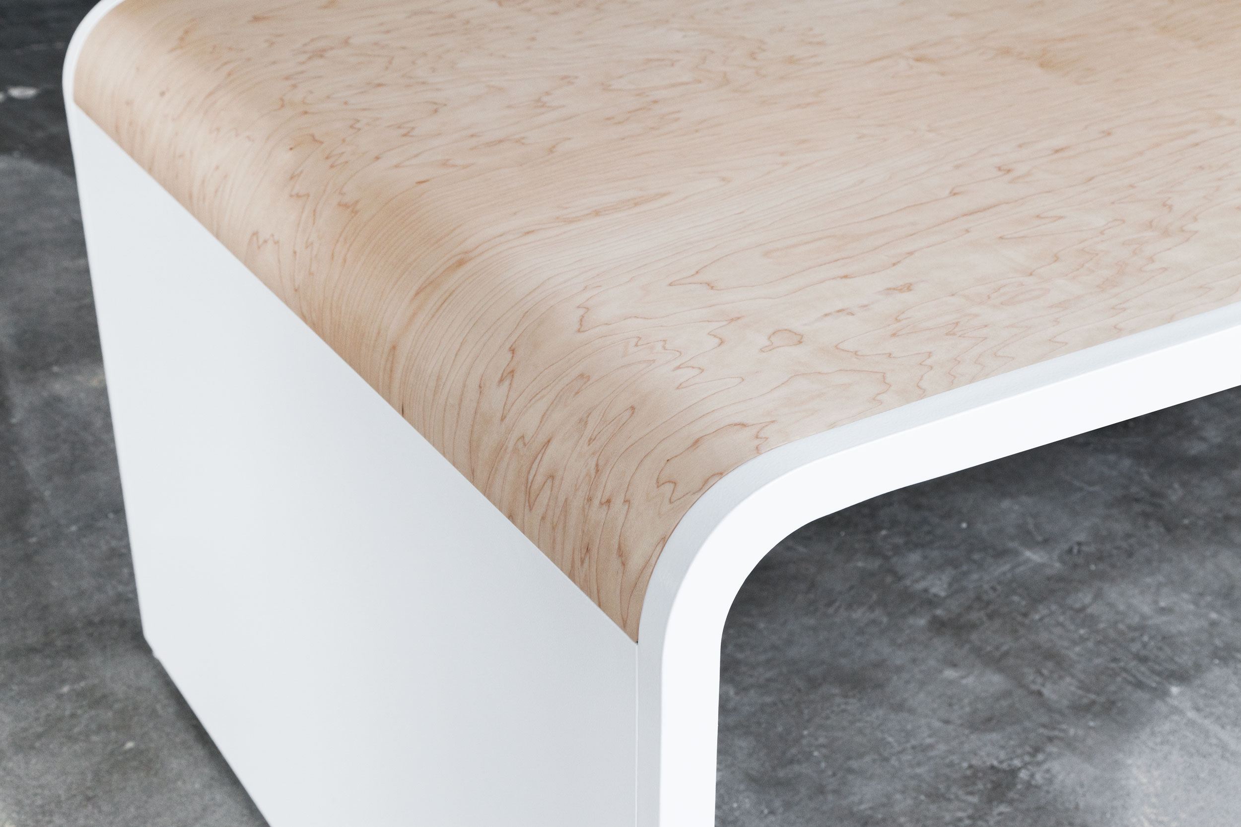 The first of two tables is 36 feet long, and made of bent steel and maple plywood veneer. The table was designed and engineered in 4 sections so that it could be fabricated by local craftsman in Los Angeles and shipped to Atlanta.