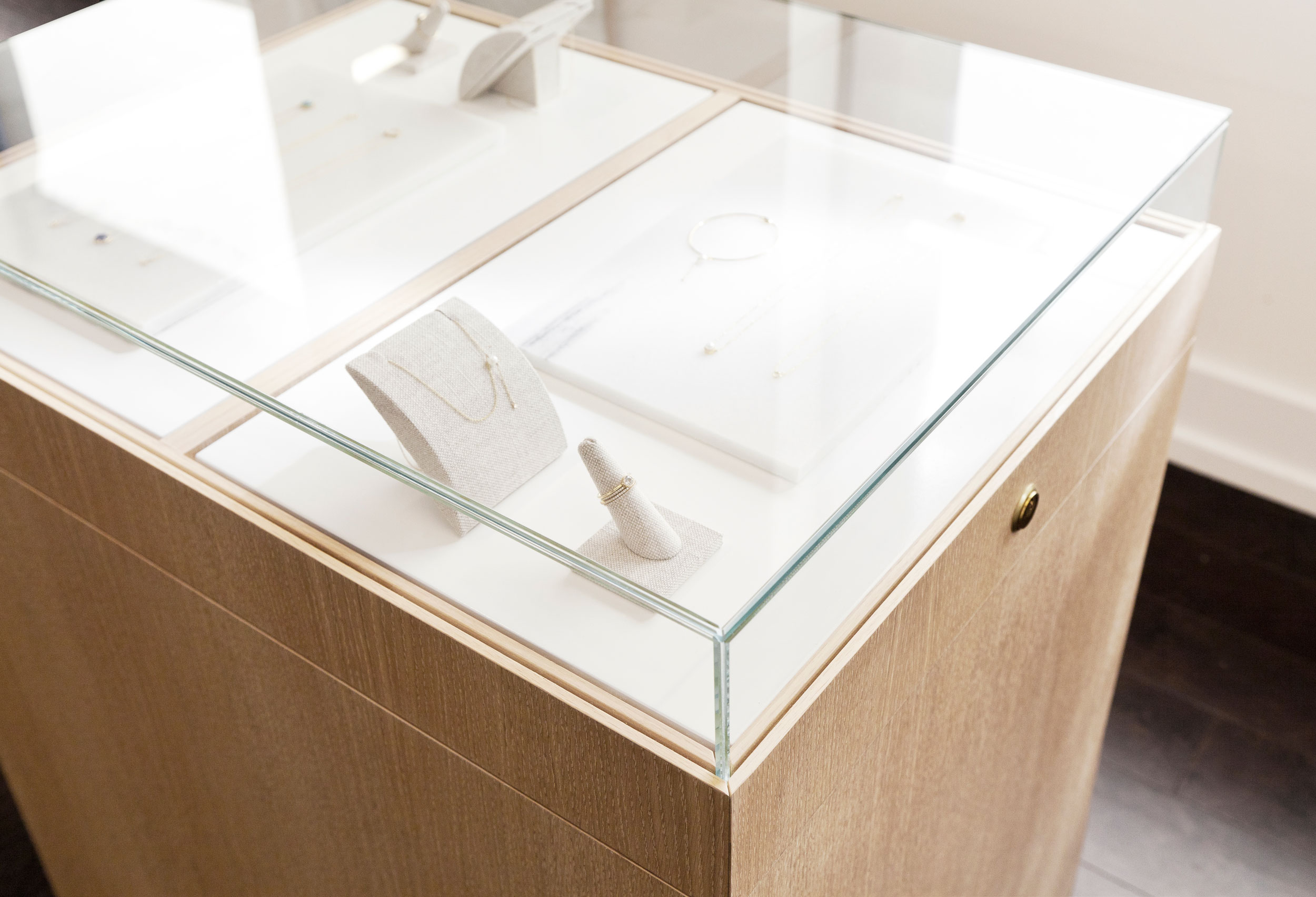 We styled the interiors of the jewelry cases as well, employing the use of traditional linen jewelry holders alongside textured marble off-cuts.