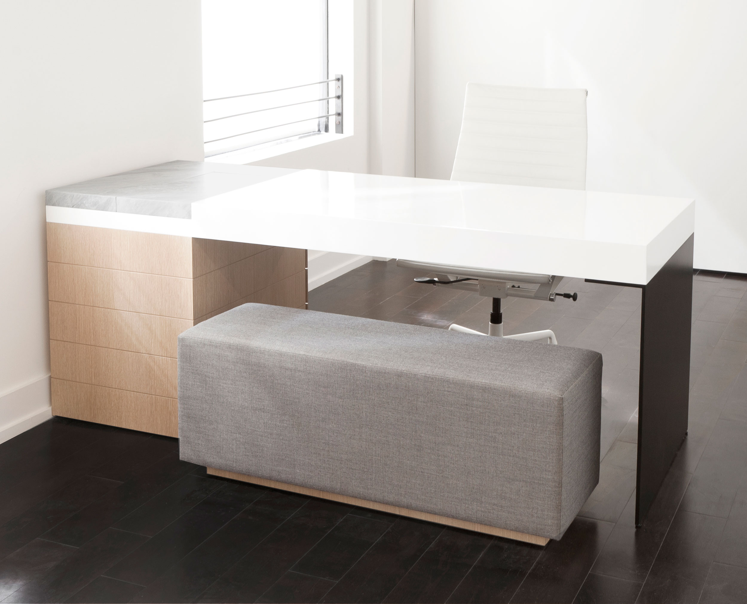 Grace's appointment desk, inspired by the concept of stacking, was designed and built using a single bent sheet of aluminum, white oak, lacquered MDF and marble.