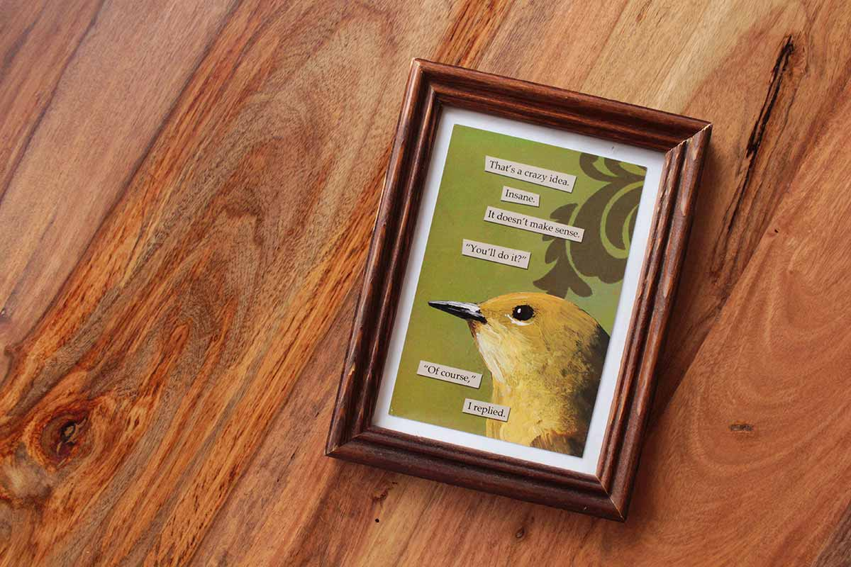 Simply Gifted:  Simple, thoughtful gift idea. Take a postcard and frame it!