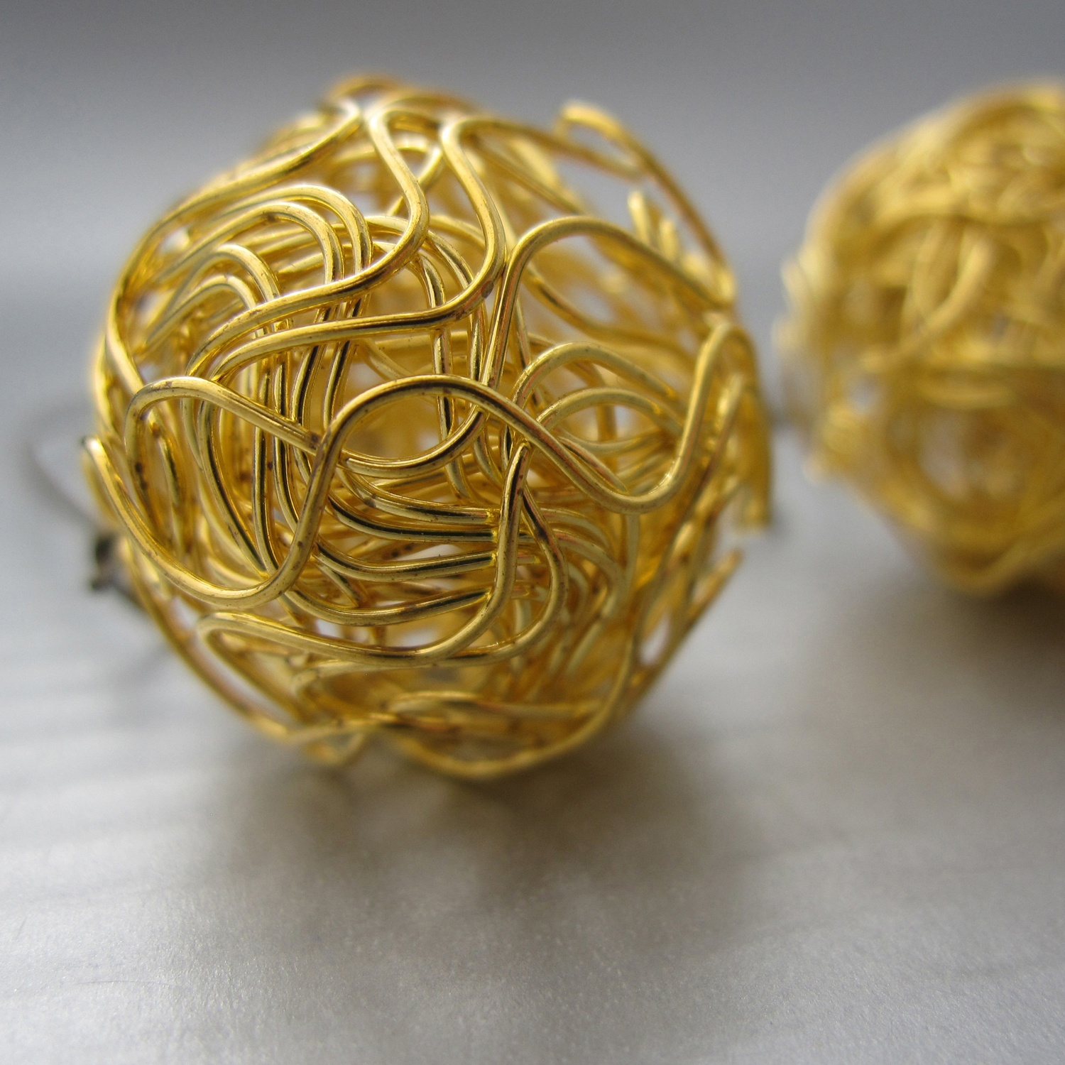 a detail of the nido earrings