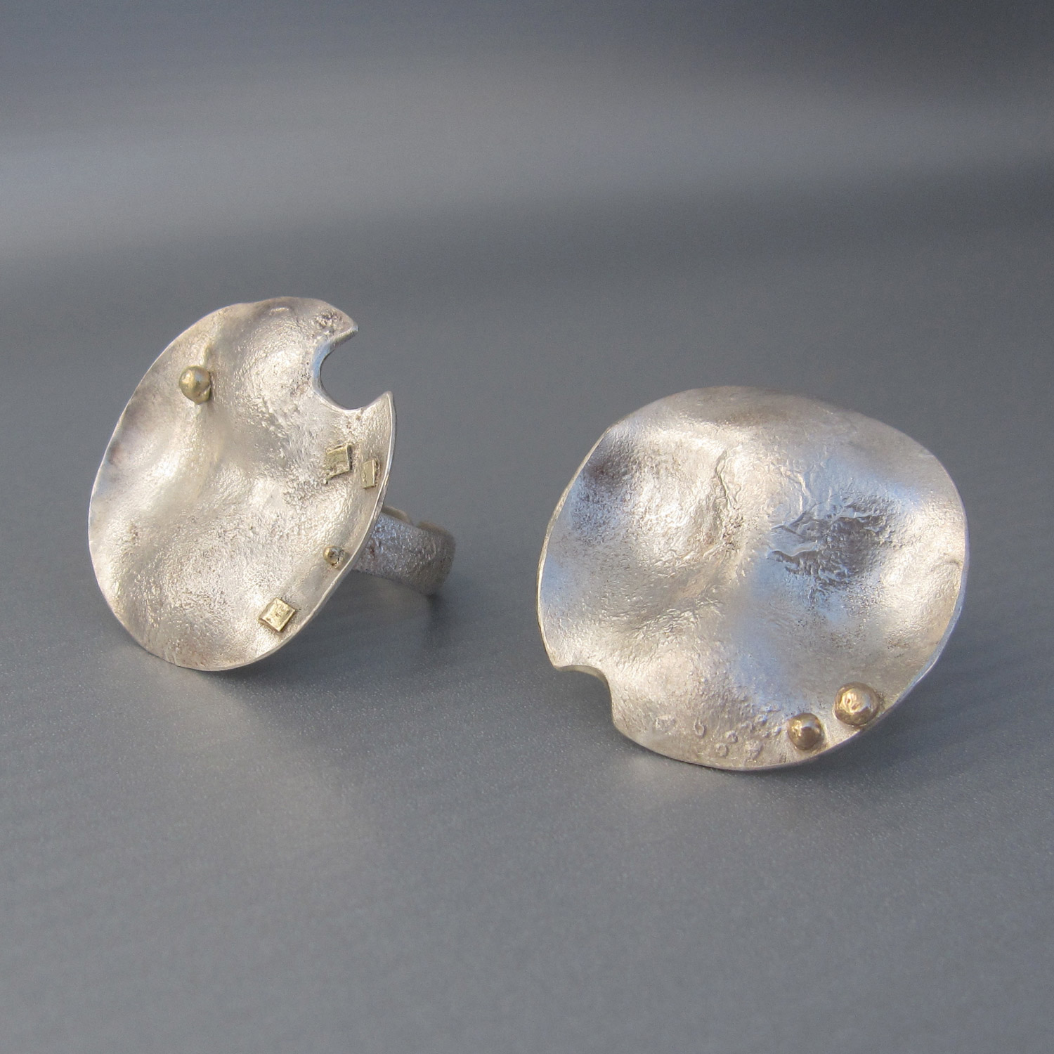 "This statement ""lunare"" rings are handmade in reclaimed silver and gold"