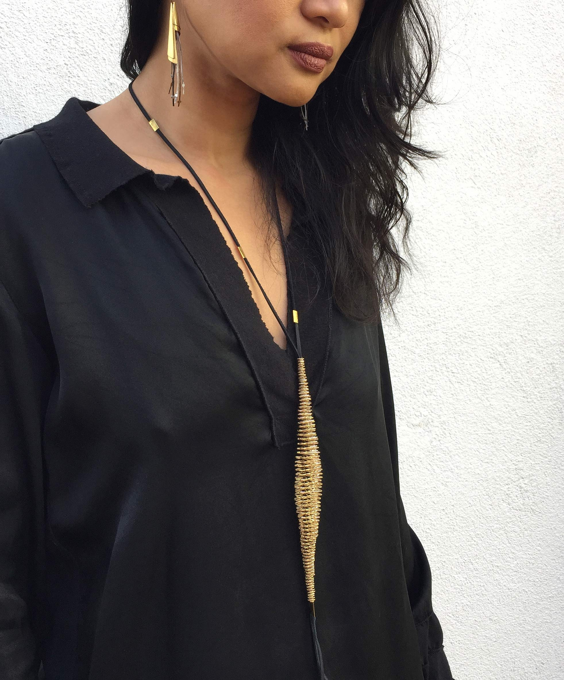 The handmade and one of a kind millepiede necklace and medusa earrings look great on Andrea