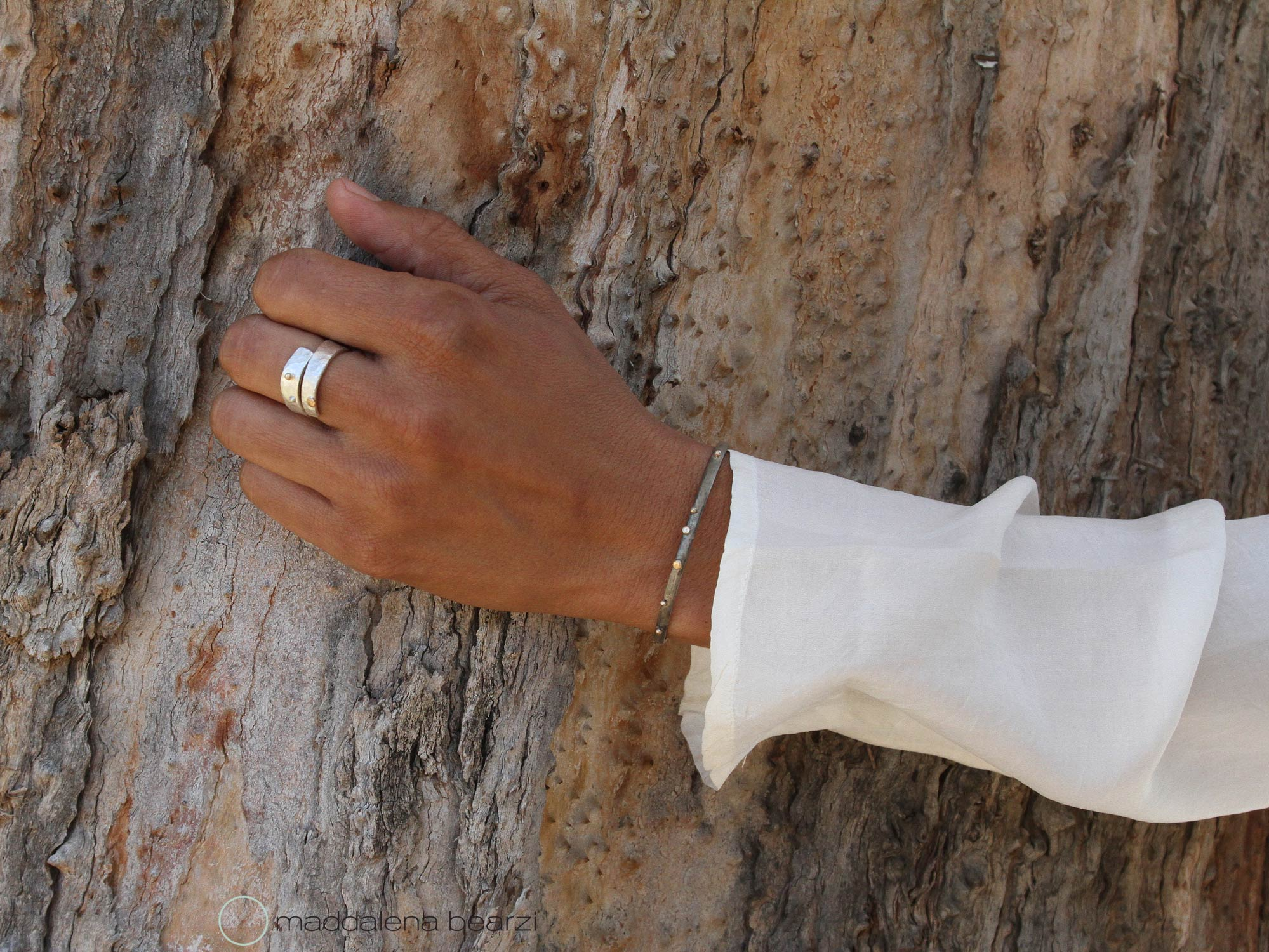 Handcrafted ring and bracelet in silver and solid gold from Maddalena Bearzi jewelry
