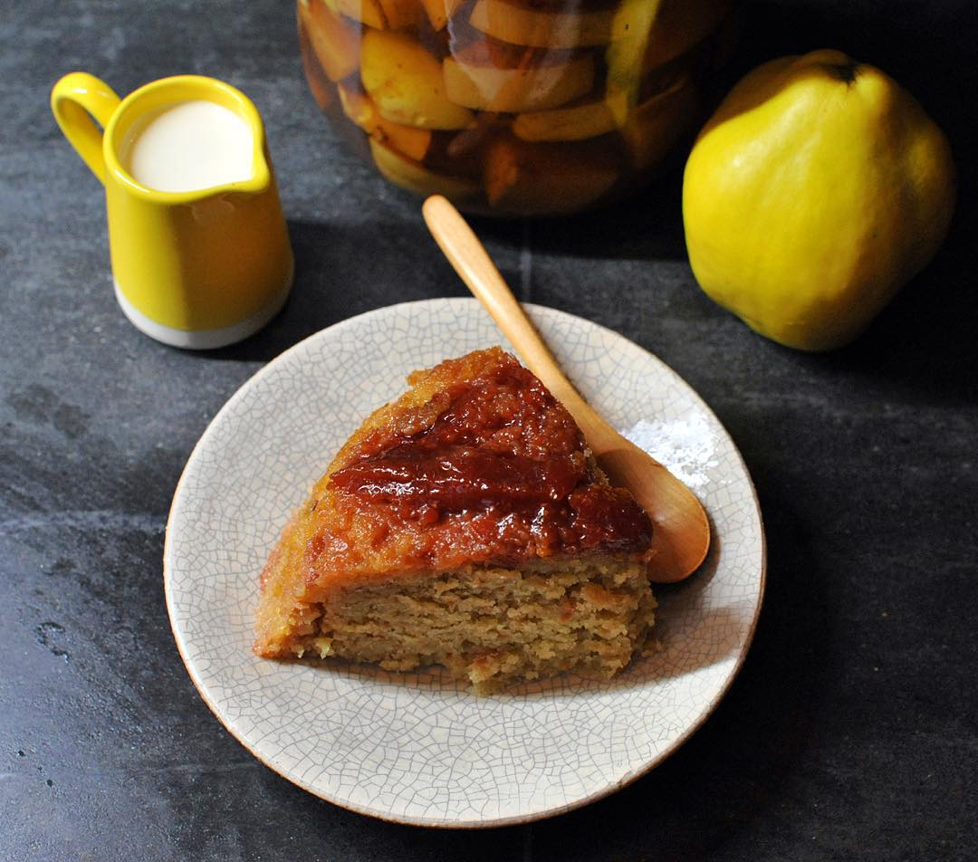 Quince steamed pudding served with cream and quince brandy.
