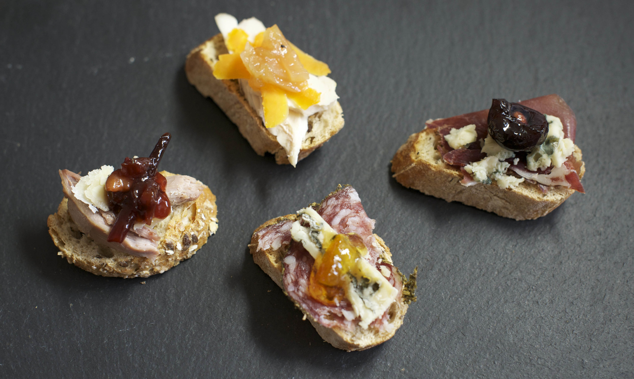 Smy Goodness canapes - (from left) Roast duck, parmesan and plum gumbo; Chicken, Red leicester and apple and pepper chutney; Salami, gorgonzola and Seville orange marmalade; Prosciutto, gorgonzola and black cherry and black pepper compote.