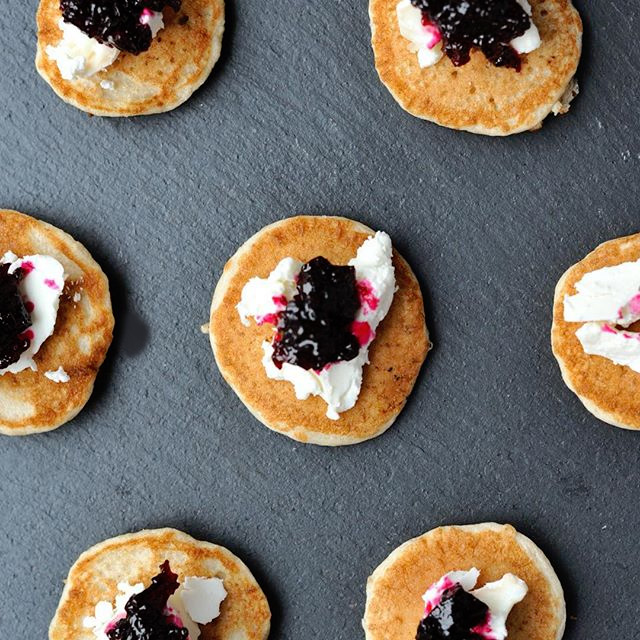 Homemade buckwheat blini topped with goatscheese and Smy Goodness beetroot reduction.